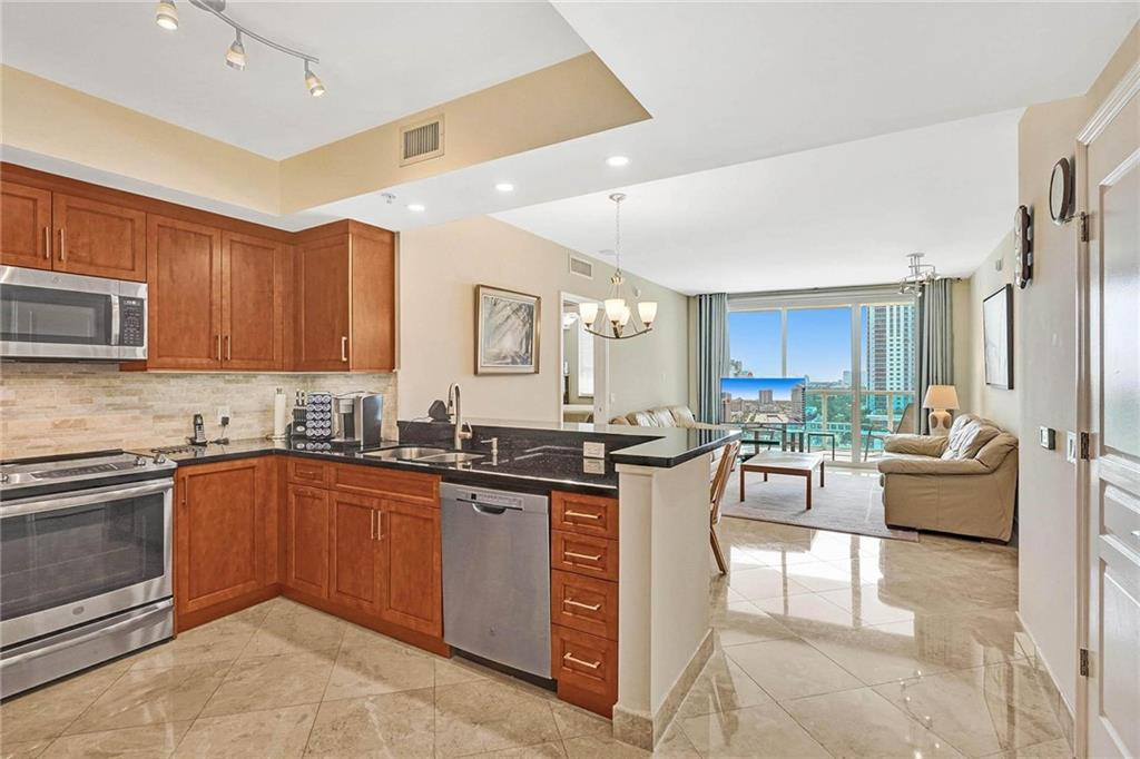 Spectacular 2 bed, 2 bath condo located on the 17th floor right off Las Olas Boulevard in Downtown Ft. Lauderdale. Large, open floor plan with a renovated kitchen and bathrooms, including beautiful east views of the city skyline and ocean. Unit has extended balcony, a storage unit and preferred parking. Walk to local shops, restaurants, bars and much more. 350 Las Olas Place is a full-service building & features its amenities on the rooftop, including a pool and gym with stunning views! Besides the standard features, the HOA includes Comcast high-speed internet, HBO, Showtime, 24/7 Security, Valet and a pet park. **Brand new A/C and Washer and Dryer in unit**