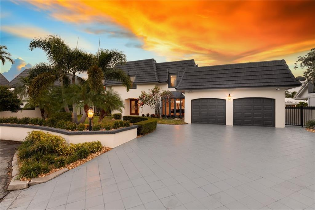 Here's your opportunity to live on the water in Coral Ridge Country Club Estates. One house from the intracoastal with breathtaking views from almost every room. This exquisite two-story home, on 85 feet of deep water, will provide you the comforts to live life to the fullest! The home is appointed with beautiful marble and tile floors circular staircase. The spacious living areas include, a family room, game room and expansive windows which all offer an air of grandeur, yet distinctive intimacy. This amazing property has 5 Bedrooms and 4.5 bathrooms. You'll experience the relaxing lifestyle of outdoor living leading to the dock which will accommodates a magnificent yacht.