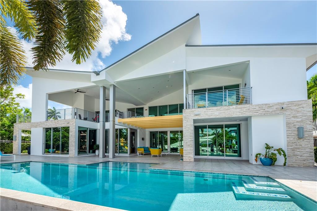 """""""CUSTOM TRANSITIONAL CONTEMPORARY"""" PRIME 100' OF DEEP WATER DOCKAGE IN SOUTH LAS OLAS LOCATION! 5 MINUTES TO PORT EVERGLADES, 5 MINUTE WALK TO BEACH AND DOWNTOWN FORT LAUDERDALE! LABOR OF LOVE CUSTOM BUILT IN 2014 WITH PREMIUM DETAILS! TOP OF THE LINE FLEETWOOD WINDOW AND DOOR PACKAGE WITH ZERO POST SLIDING DOORS! ALL CONCRETE AND STEEL CONSTRUCTION! AUTOMATED PUSH BUTTON LIGHTING AND DRAPE CONTROLS! 8,100+ SF GROSS 4,653 SF UNDER AIR 3 CAR GARAGE, ELEVATOR AND TROPICAL POOL! 5 BEDROOMS ALL WITH ENSUITE BATHROOMS! HUGE OUTDOOR GYM! GROUND FLOOR MASTER SUITE! GAS GOURMET KITCHEN WITH ALL OF THE BEST APPLIANCES! THIS STUNNING CUSTOM RESIDENCE OFFERS THE FINEST ELEMENTS OF MODERN ARCHITECTURE!"""