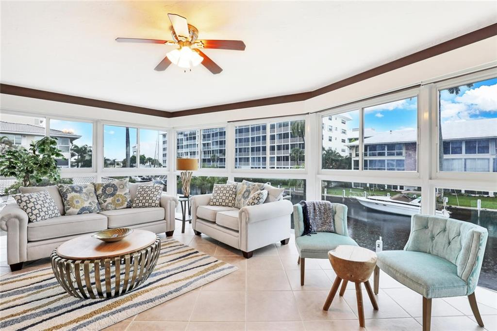 Spectacular rarely available corner unit with lots of windows and water views. Located on 2nd floor at the Windsor Condo in the Coral Ridge Country Club Neighborhood, this beautiful open 3 bedroom 2 full bath waterfront condominium is one of a kind. Floor to ceiling IMPACT windows brings in lots of natural light andb eautiful water views! Ceramic tile and laminate flooring throughout tastefully updated kitchen and bathrooms. Short walk distance to everything you want, restaurants, beaches, parks, boating, nightlife and entertainment. Boat docks are available, ocean access no fixed bridges. Unit comes with covered assignedparking space. Plenty of guest parking. Max boat size 35' One of a kind corner unit, NO Leasing. Covered parking