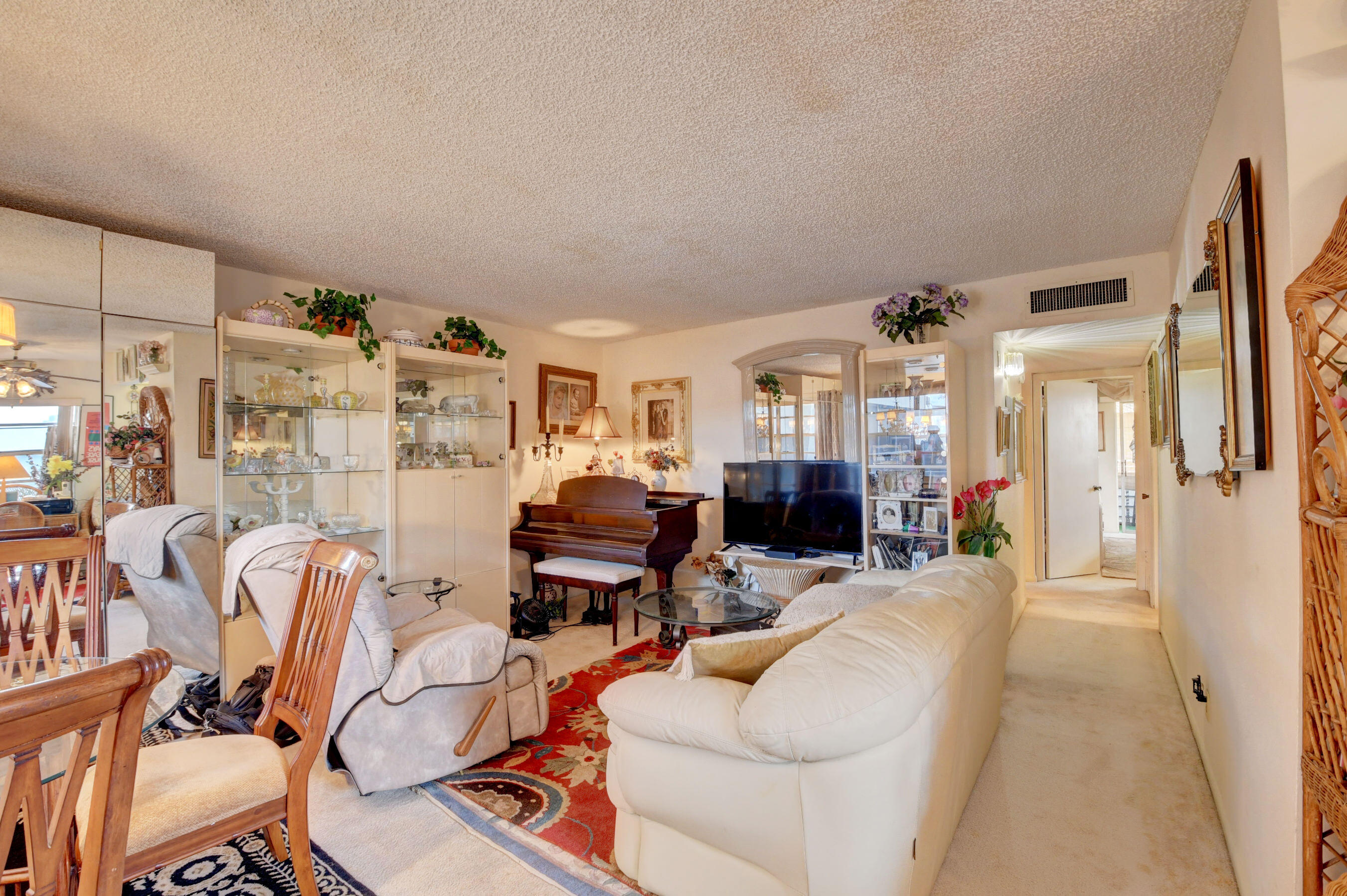 Corner two story Normandy 2 bedroom 2 bath unit with brand new A/C in 2021 and water heater in 2018.  The condo is offered fully furnished minus the personal items and includes a washer/dryer.  Schedule your showing today.