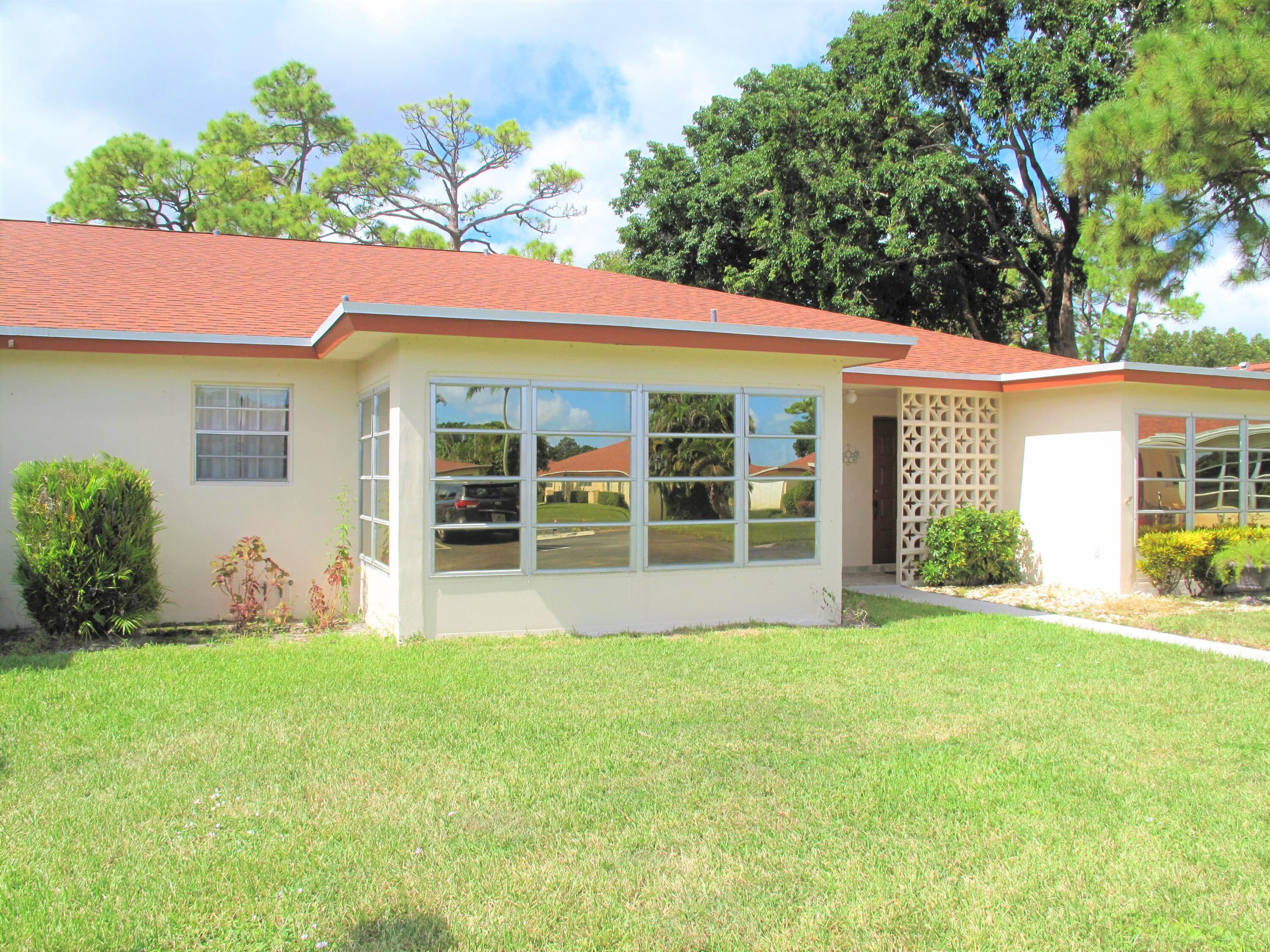 Great location of this 1BR/2BA pristine villa nestled in a 55+ community. This mint villa features: New 2020 electrical Panel,  New AC Jan 2020, Newer roof 2019, Laminate wood flooring throughout, enclosed Florida room under air w/tile flooring, galley kitchen with high hats and new flooring, Guest bathroom has a separate shower. Make this villa your new piece of paradise. Enjoy Florida living at its best in this very active 55+ community where you'll enjoy many planned social activities, game night, traveling, large heated resort style pool and clubhouse and so much more. Located closed to all amenities, just minutes to the beach and downtown Delray where you'll discover quaint shops, open air cafes, fine restaurants, shopping malls, theater, close to I95/Turnpike and  Places of worship.