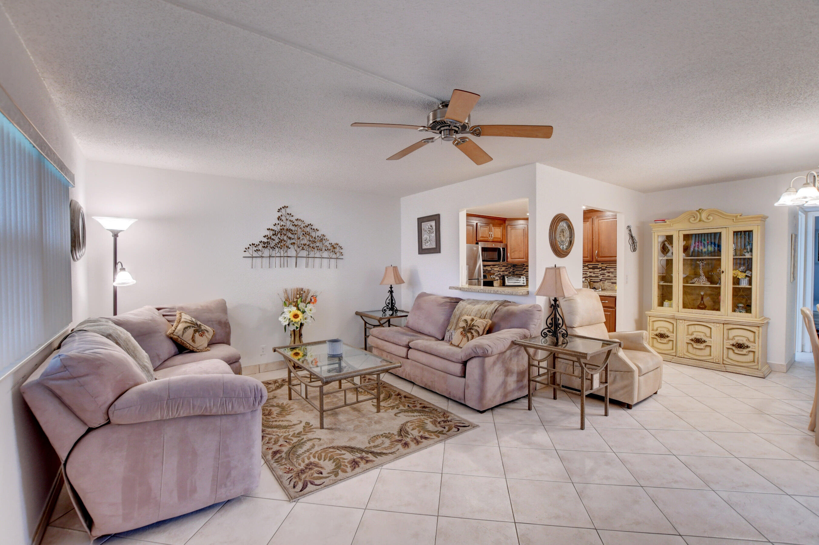 Just Listed Furnished Ground Floor condo right next to the Monaco Clubhouse. Remodeled Kitchen with stainless steel appliances and recessed lighting. Tile flooring in living area. Updated master bathroom , recessed lighting. Enclosed Patio with AC and washer and dryer in the patio. Compliant electrical box. This is A MUST SEE !