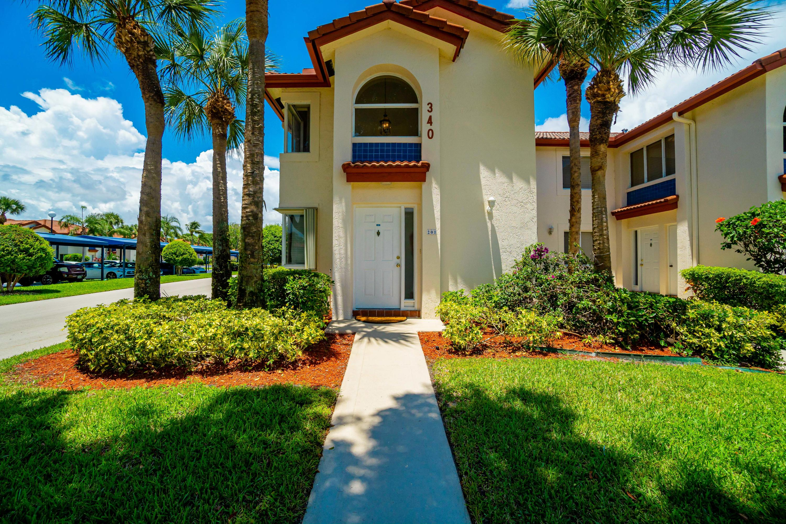 Beautiful 3 bedroom & 2 bath condo located in a charming San de Vance community in east Boca Raton, just minutes away from the beautiful beaches. This corner unit with private ground floor entry has vaulted ceilings & extra windows for plenty of natural light, spacious eat-in kitchen with stainless steel appliances, split floor plan with 3 bedrooms & 2 full baths, large walk-in master closet, a separate laundry room & a spacious screened balcony. The condo comes with a shared storage room & a covered assigned parking spot. San de Vance is a pet friendly community with great amenities: heated pool, fitness room, tennis and pickle ball court, clubhouse, BBQ grills, car wash area, passive entry gate, etc. Condo fee covers upgraded cable, high-speed internet, water, building insurance & more.