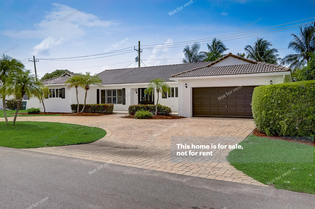 This Fort Lauderdale one-story home offers an in-ground pool, granite countertops, and a two-car garage. This home has been virtually staged to illustrate its potential.