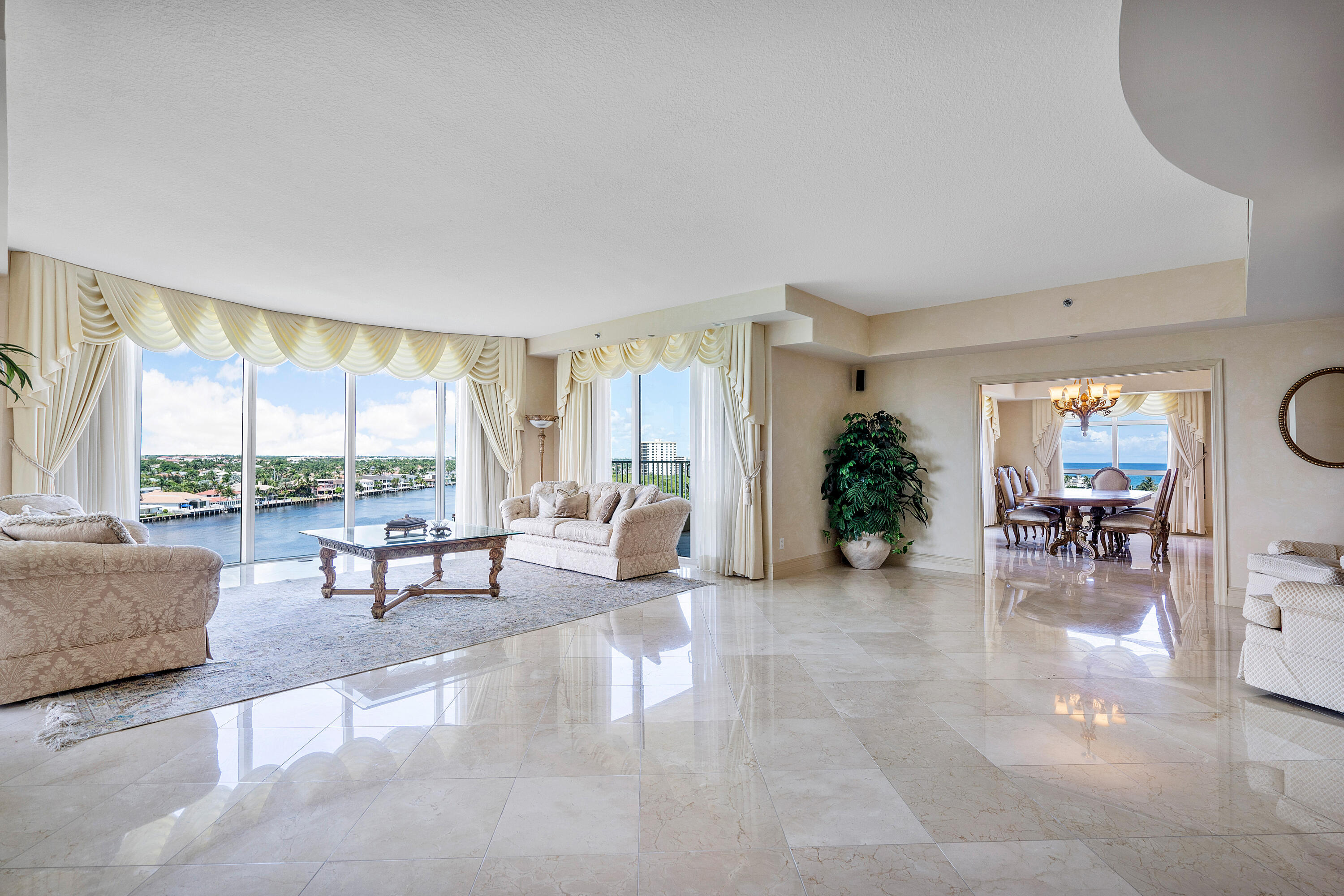 From the moment you enter your private elevator entrance you are welcomed with over 5,400sqft of open living space and 360 degrees of drop dead gorgeous intracoastal waterway & ocean views from every room. This luxury residence boasts 5 spacious ensuite bedrooms & baths, plus powder bath, formal dining & great room. Each room offers large private balconies to enjoy the magnificent sunrise & sunset water and resort views totaling over an additional 1,000sqft. Boasting a chef's kitchen with large island and ample storage space with kitchen nook facing turquoise ocean waters. Over 9 Ultra-large walk-in closets throughout residence, polished marble flooring in main living areas, grand atrium foyer with direct waterway views from the floor to ceiling glass windows, high ceilings and stunning... all marble bathrooms with frameless glass showers & jetted soaking tubs are just a few of the key attributes to this home. Great room features a wet bar for entertaining and private balcony. Fabulous over-sized laundry room w/ sink and private trash-chute for ease. The residence is impact glass complete and includes 2 garage parking spaces. Toscana truly offers world class South Florida luxury living with everything right at your fingertips. The Toscana community lifestyle includes exclusive direct ocean access beach club, tennis, multiple resort pools, expansive fitness center, sauna, billiards & game room, clubroom, ample private lounging areas throughout property, valet parking and 24/7 security with a manned gate. You are 5 minutes to iconic Atlantic Ave in Delray offering award winning dining and shopping.