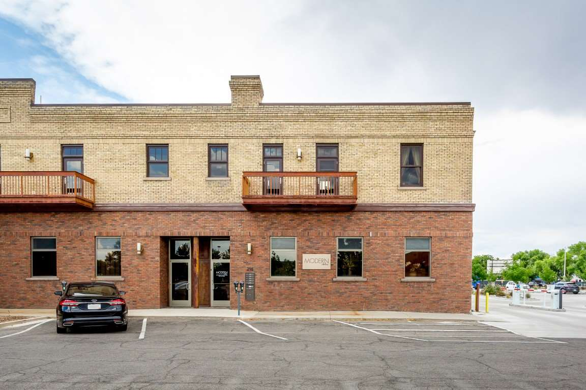 One of very few high end downtown Grand Junction condos featuring a unique mixture and combination of contemporary and rustic finishes throughout.  The condo is comprised of both residential and commercial space.  2 bedrooms, 2 bathrooms and 1319 SF make up the residential portion while 823 SF and a half bath are designated to the main level commercial space along with 832 SF of finished basement square footage.  Finishes include vaulted ceilings, wood beams, exposed brick, concrete window sills, wood floors, stainless appliances, street-side balcony and roof top patio, along with high efficiency geo-thermal heating and cooling.  The residential and commercial space are parceled together and cannot be sold separately.  Enjoy all downtown Grand Junction has to offer in this unique live/work, mixed-use setup.  Separate entrances: Live in the residential  space & lease the commercial space,
