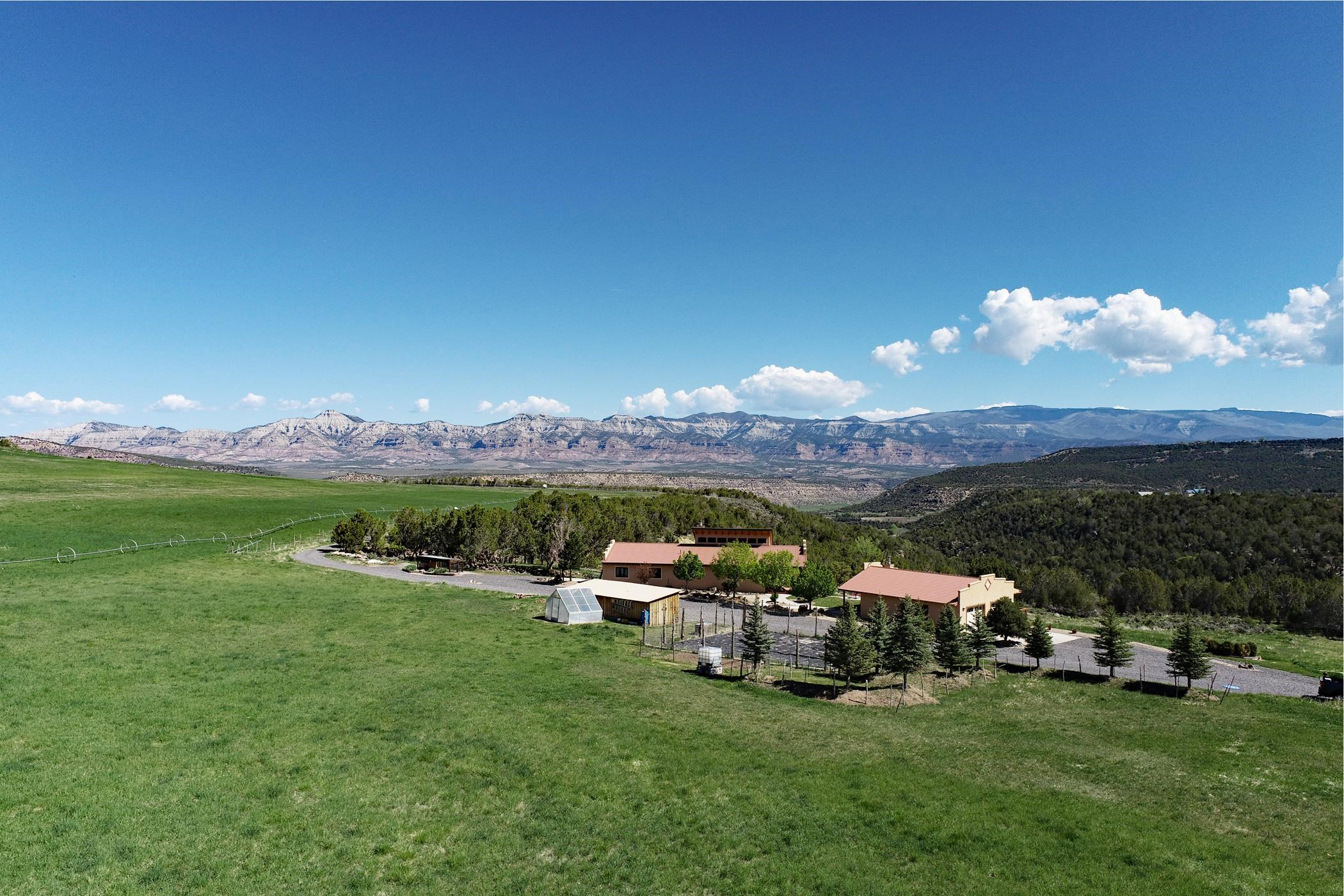 345+ acre mountain ranch with irrigation, spring, side roll, pivots, hay/grass crop and pasture, pond, green house, equipment shed, stack yard and garden area. BLM borders two sides of property with deeded access and a grazing permit is included. Custom built with ICF construction 3048 sq ft 3 bd, 3 bath home. Travertine tiled floors and carpet throughout. Spacious gourmet kitchen with granite countertops, maple cabinets, stainless steel appliances, huge pantry, and breakfast bar. Quality craftsmanship with vaulted wood ceilings, rock fireplace and in floor radiant heat all add to the deep warmth of the living space. Amazing mountain, valley views and terrific hunting property in Unit 421. Double car garage is attached to the guest house. Offer your guests a retreat with wood stove, efficiency kitchen, kegerator, ¾ bath. Come enjoy this private sanctuary.