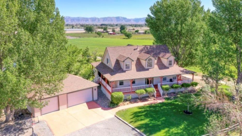 360' Views, 17.60 irrigated acres ,mature trees/landscape + 2 ponds! 2 story home with full finished walkout basement (4,841 sq. ft. home) and 1128 sq. ft. of covered porches. All this located at the end of a cul-de-sac where quiet and privacy are abundant. Well maintained home that offers you many options for living. Potential for a mother-in-law suite on the lower level, or to accommodate your guests. Nicely appointed kitchen offers ample storage and work space with plenty of room for friends and family to gather. 3 car detached garage + a 45x30 shop with concrete floors, its own heating/cooling and electrical service ,was used for drying Hemp, but has so many possibilities: boat/RV storage, workshop/hobby area or? Both ponds are stocked with fish, or take out your paddle board/kayak and float away your stress. Field just planted in grass hay. Gated pipe for field irrigation. Paradise!