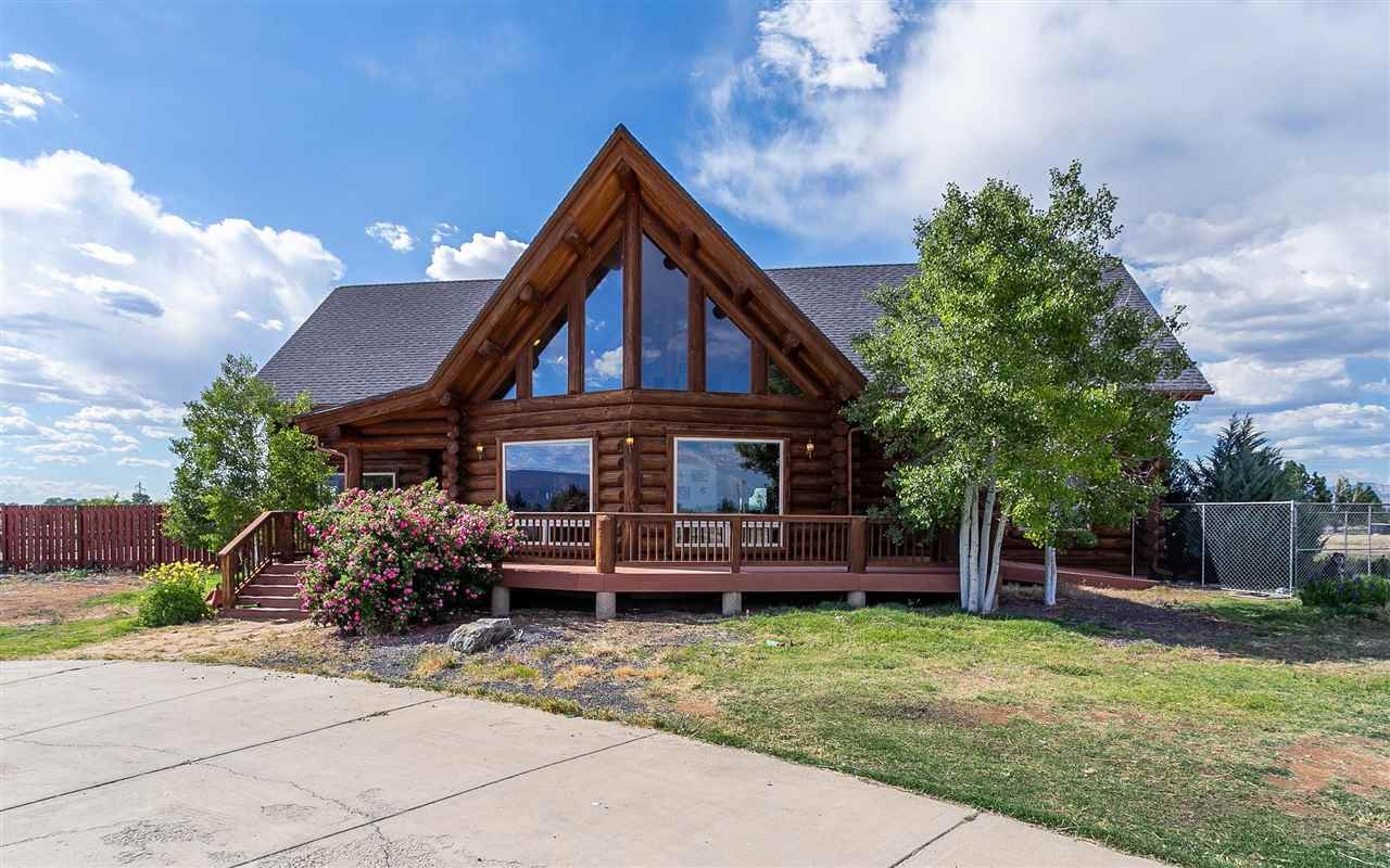 This one is truly an entertainers dream. Situated on 19.64 acres with 360° views, this beautiful log home has just under 3500sf of finished living space, and additional 1824sf enclosed pool room which houses a salt water swimming pool for year round enjoyment, and if that's not enough, there is over 1600sf in the basement to finish how you'd like or use for storage. Large windows provide tons of natural light throughout home as well as offer amazing views from every angle. Currently zoned agricultural, so bring the horses, cows, chickens, goats, etc., OR, if you prefer, this property is eligible for a small density subdivide - preliminary work is already done! The options are truly endless on this one!  Seller wants to let YOU pick the new flooring!