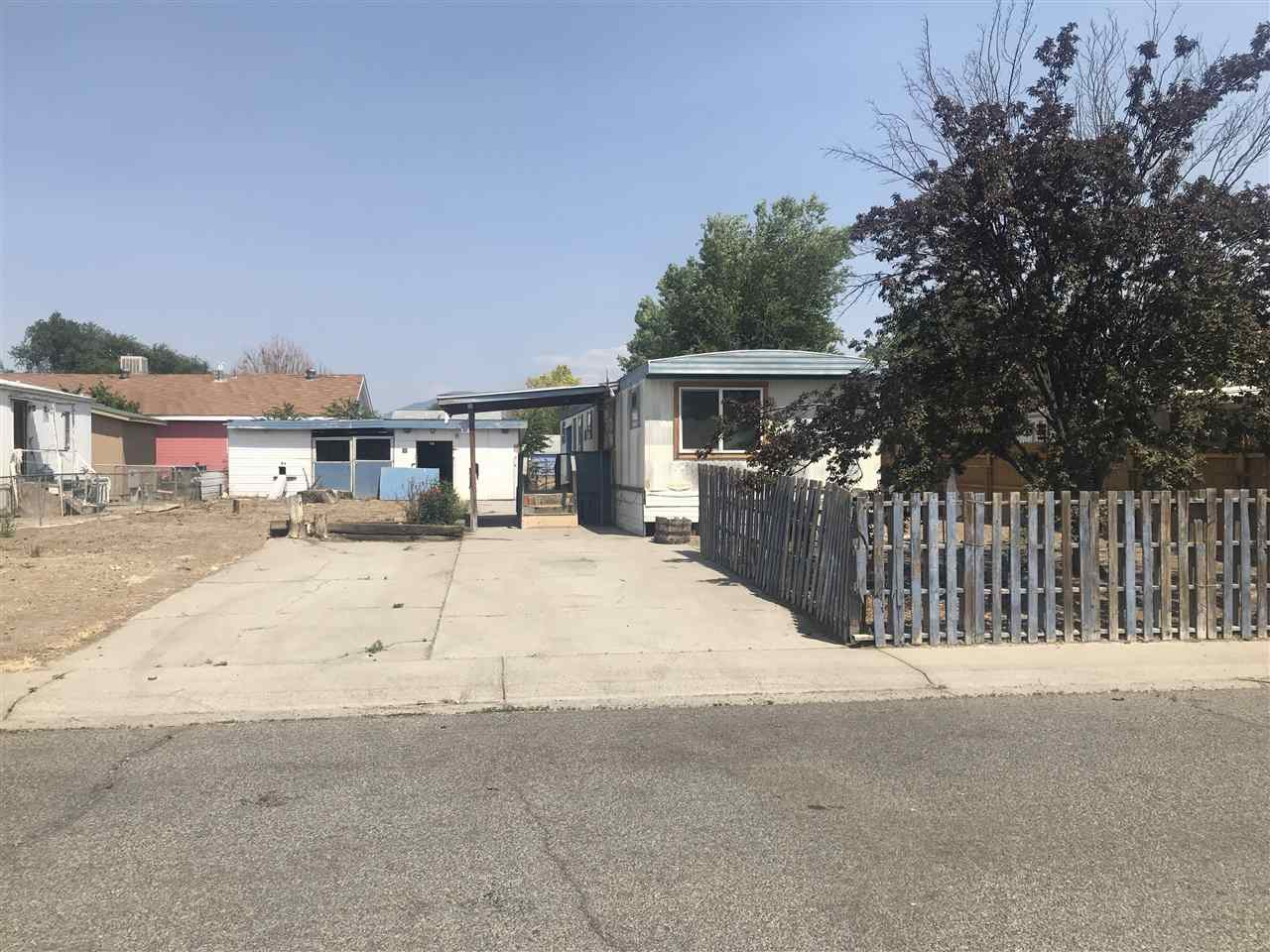 Manufactured home on OWNED lot in Northeast Grand Junction. The home needs some TLC, but also comes with a large outdoor storage shed and a cleared lot. The fixer-upper is located in a living community with no monthly dues or HOA fees! Close to area schools and shopping! Mature tree on site and the potential to landscape to your favored design specs! Bring your offers!