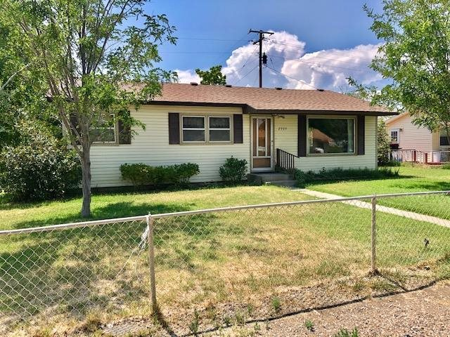 Great opportunity for improvements to freshen up this home! Solid home with some deferred maintenance. Newer roof shingles & vinyl siding. Fully fenced, corner lot, in existing subdivision. Ranch style, 1407 SQFT, 3 Bed, 2 Bath. Includes all kitchen appliances plus washer & dryer. Part of the 2-car garage finished into a bedroom with no heat/cooling- not counted in the square footage. Hardwood floor in bedrooms, under carpet in the living room & hallway. Freestanding wood stove in Family room that is finished on the back of the house. Home will not qualify for financing possibly FHA 203K- will most likely be a cash transaction.