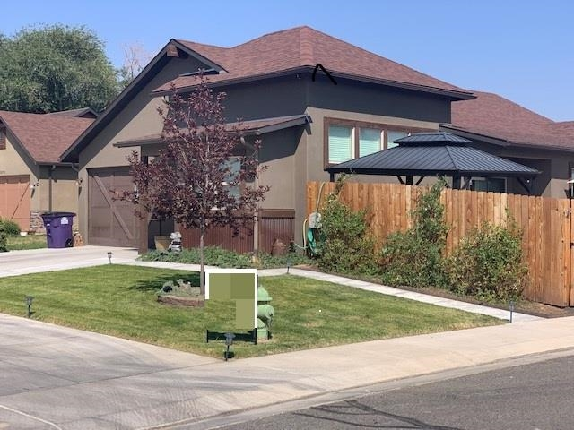 THIS IA A WINNER, GET IN NOW AND MAKE IT YOURS, OPEN Concept, Vaulted ceilings, spacious  feeling, open and Bright, kitchen/w center island with sink & counter space & breakfast bar, ,includes $3500, Frig/freezer + dining room with sliding  glass doors to outside patios & beautiful back yard & garden area,  Ceiling fan in master BR, vaulted ceilings in bedrooms,  double sinks, walk in tiled shower & walk in closet. 2 Additional bedrooms and guest bathroom.Garage access thru laundry room Central HVAC