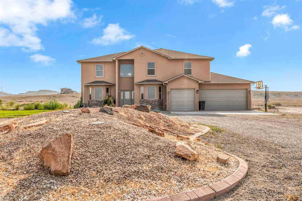 Wonderful custom built home by homeowner on 8 acres of land. The amazing views of the Monument and Grand Mesa will not disappoint! Beautiful bamboo flooring on the main level, 5 burner gas cooktop in the kitchen to accompany the all stainless steel appliances. Upstairs has the master bedroom and bathroom that has a two way fireplace. Off the master bedroom is a great deck, perfect for viewing the landscape. Get in today before this property is gone!
