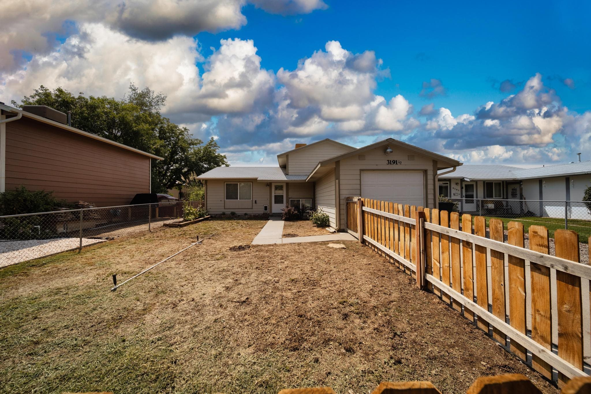 Quaint home with convenient location, ready for you to move in.  Fenced front and back yards.  Covered patio and a covered area for your barbeque.  Ideal floor plan with 2 bedrooms and 1 bath upstairs and 1 bedroom and 2nd bath downstairs with a family room, gives everyone space to roam and hangout.  It even has a garage and new windows!  Come check it out!