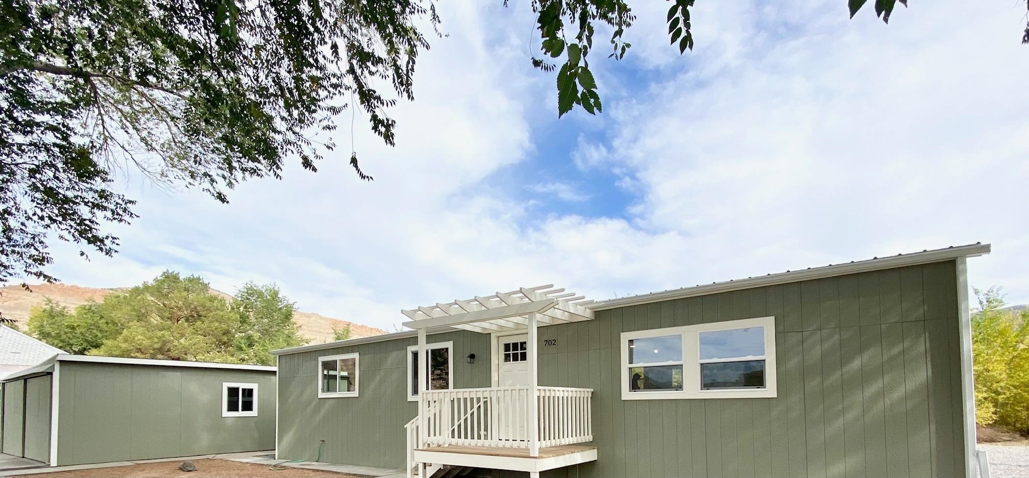 Adorable home completely renovated in 2020 in the heart of Palisade! Location is amazing, almost half an acre next to wineries and biking distance to Downtown Palisade. Tons of toy or RV parking. Upgrades include new roof, siding, HVAC, electrical, plumbing, floors and so much more! Don't miss out, schedule your private showing today.