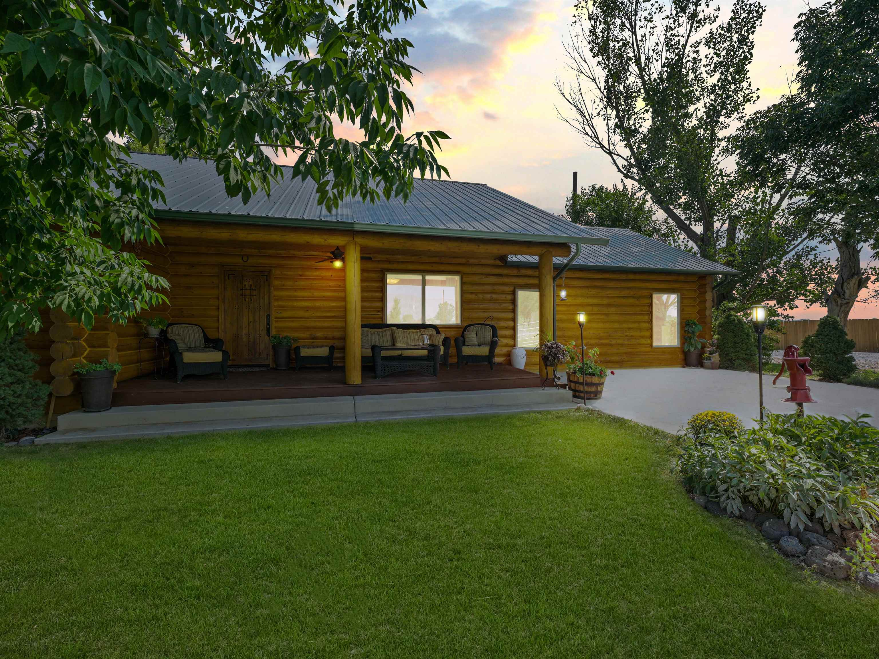 Don't miss this riverfront property & Western Colorado country living opportunity! The back porch overlooks your own private pond & the Colorado River. The front has views of Mt Garfield & the Bookcliffs. There is private access to the Colorado River & nearly 10 acres of land for horses, hobby farm, crops, garden, toys, RVs & more. This property also sits right on the Palisade Wine Tour route. The stunning log home has vaulted ceilings & plenty of windows to see views of the Grand Mesa & Colorado National Monument. The master suite has a private patio, floor-to-ceiling windows, walk-in closet & 5-piece bath. Secondary bedrooms are junior suites. Both uncovered & covered patios are out back & a covered deck in front. The pond is stocked for fishing & the oversized garage is insulated with 220 power. This location is close to both Grand Junction & Palisade. Book your private tour today!