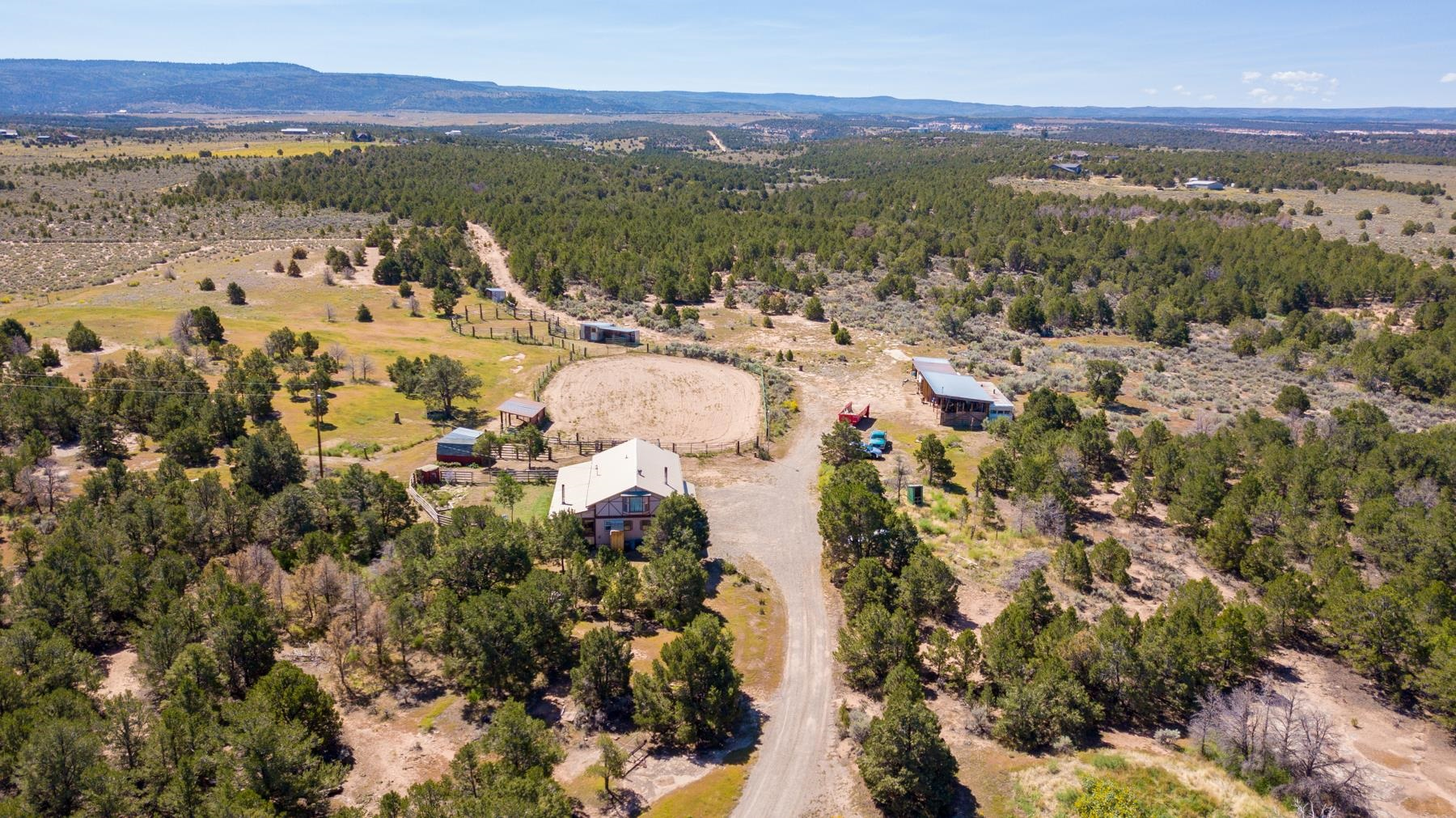 2+2 Quarter Horse Ranch.  Wonderful Glade Park horse property on over 37 acres.  This property features 1920 sf in the home, round pen, riding arena, shop, multiple outbuildings, beautiful views, and lots of trees. The acreage is ready for you and your horses!