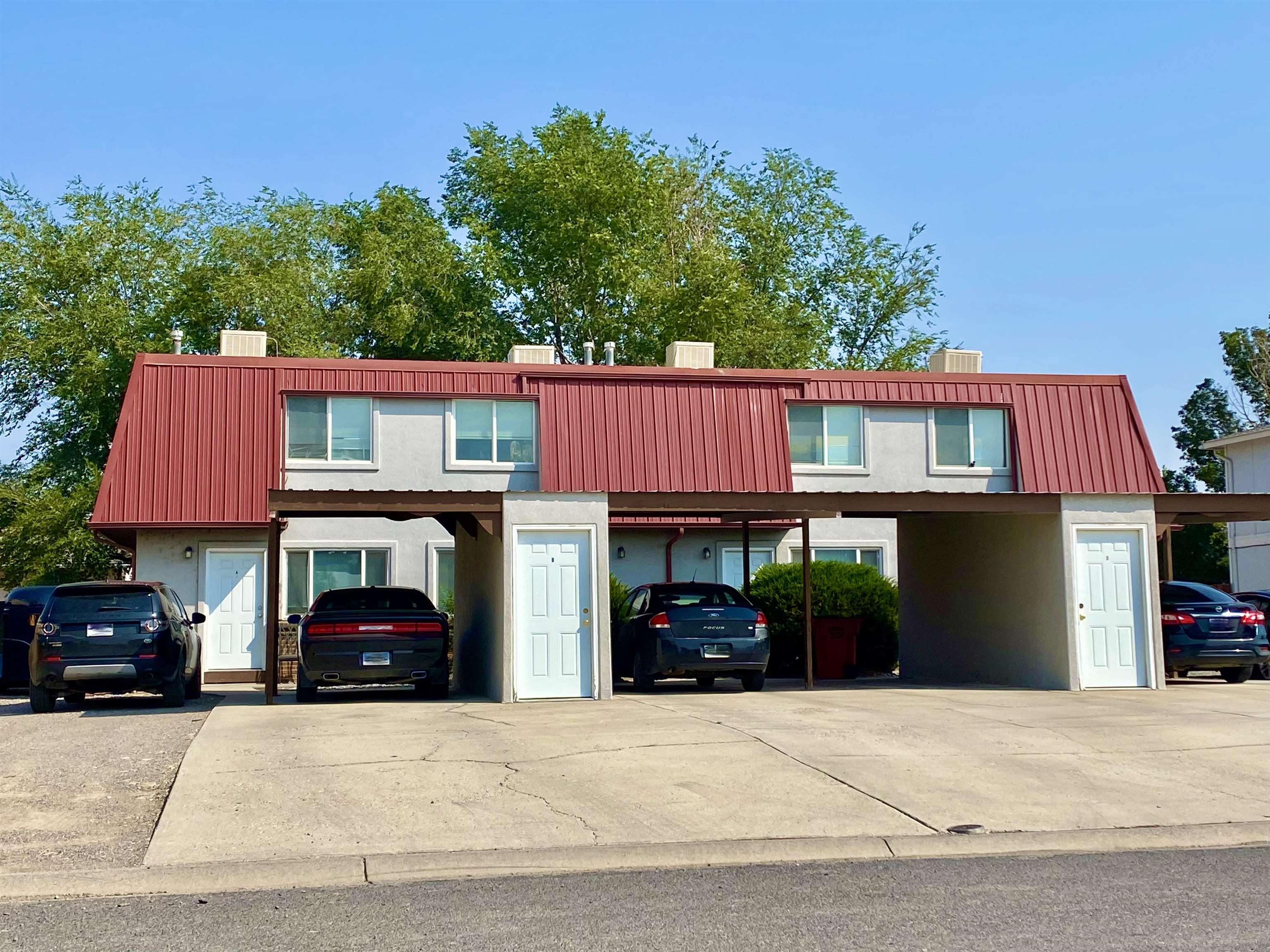 Take advantage of this great investment opportunity! All units are currently rented. The roof was replaced with metal, exterior is stucco and each unit comes with their own storage unit. Each unit has their own private fenced patio and their own carport.  All units have washer/dryer hookups. Currently tenants pay electric & gas, and have separate meters for billing convenience; owner pays for water/sewer and trash.