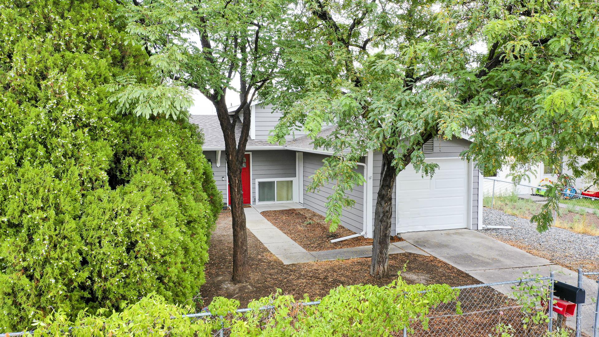 Nicely updated top to bottom & move in ready! Wonderful tri-level home w/ 3 beds, 2 baths, 1 car garage, & nearly 1200 sq ft of living space. There are 2 living areas making for great entertaining space. Great finishes throughout. Outside you will find a screened patio & xeriscaped fenced yard. Come take a closer look!!