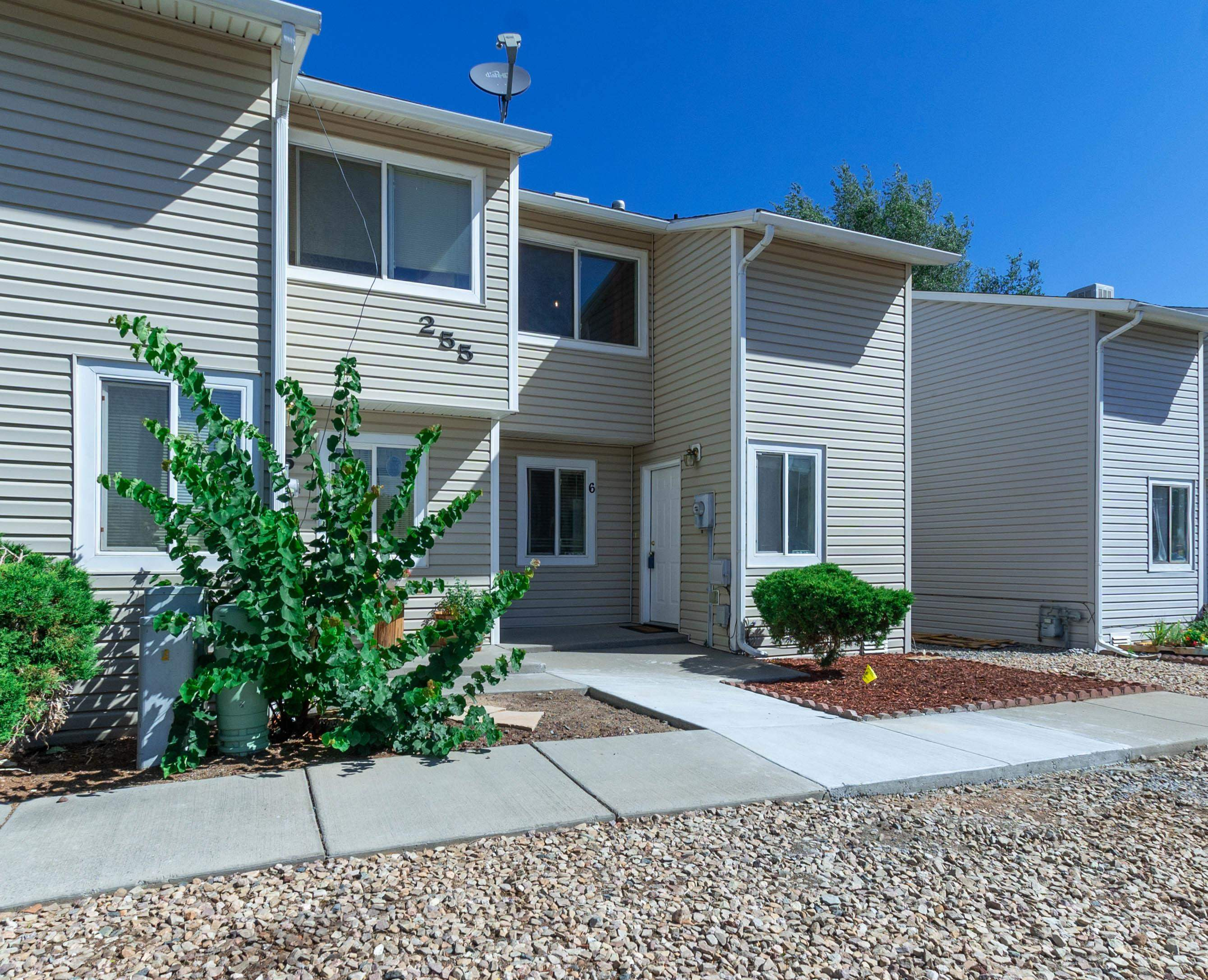 Cute end unit townhome in Orchard Mesa. Both bedrooms, full bath, and laundry area are upstairs. Master bedroom has a large walk-in closet. Stackable washer and dryer are included. Downstairs, the kitchen has a bar area that opens to the large, comfortable living room. The half bath downstairs is very convenient. The living room has sliding glass doors out to the fenced in back area. The back yard could be a play area, a dog yard, or would be perfect for BBQs. There is a small storage unit included. HOA maintains roof, outside of building, and common areas.