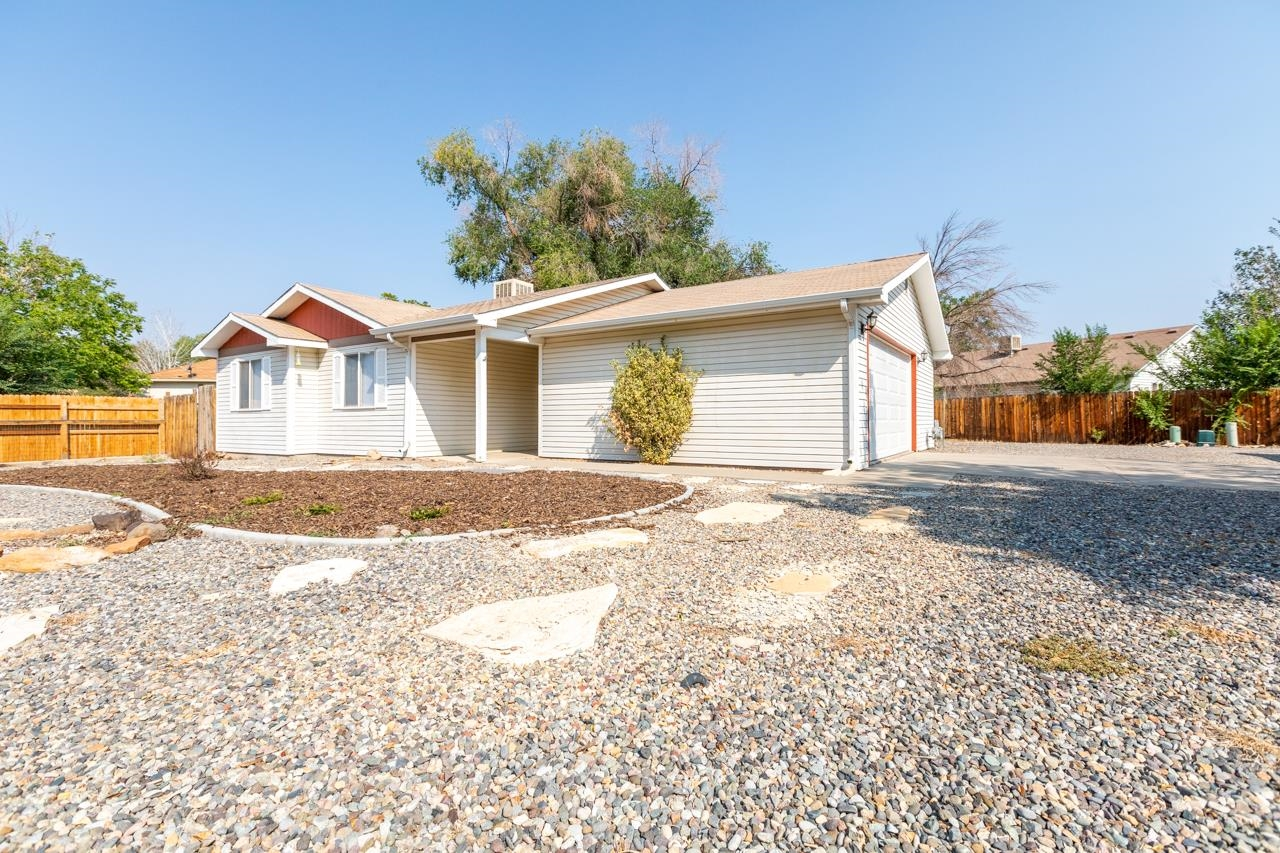It's not a typo! Good luck finding another detached house that is this clean and this new with 3 bedrooms and 2 car garage. When you step in the front door of this remarkable home you will find new flooring, fresh paint and farmhouse style ceiling fan. The kitchen has a glass tile backsplash, unique countertops and a large pantry. Just outside on the patio is a modern farmhouse style hot tub that sits two comfortably. When you go into the main bathroom don't forget to look down (they put a lot of money into the floor). There is plenty of parking and even room for a small RV. The raised bed garden is in full swing and ready for someone to make it their own next year.