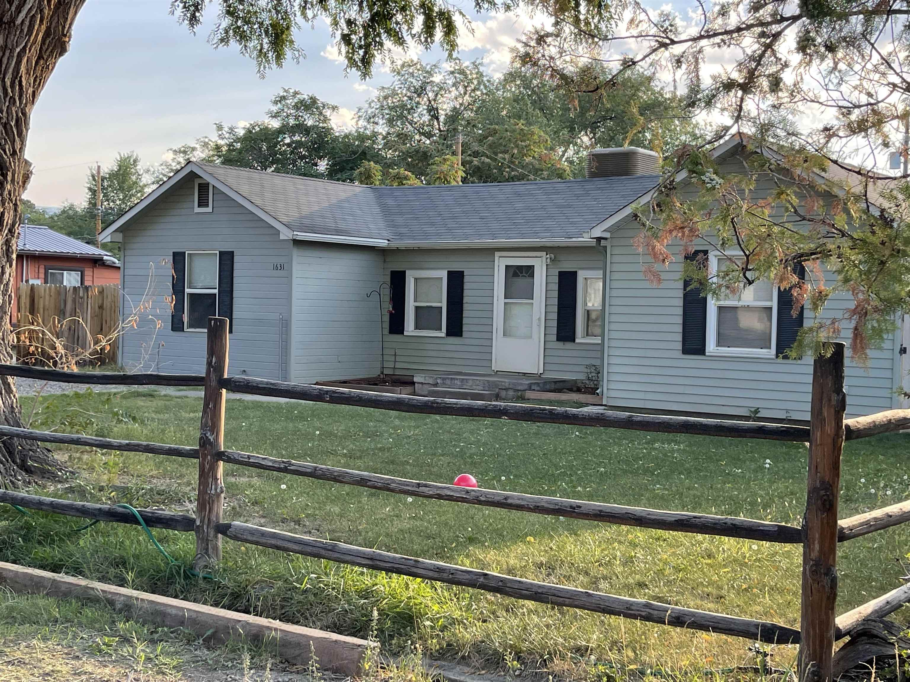 This home has a good personality and needs some love! The split bedroom floor plan with a large living room, efficient kitchen, small dining area on almost 1/4 acre, is just waiting for someone to come in and polish it up!  The home needs cosmetic work - flooring, paint and landscaping.