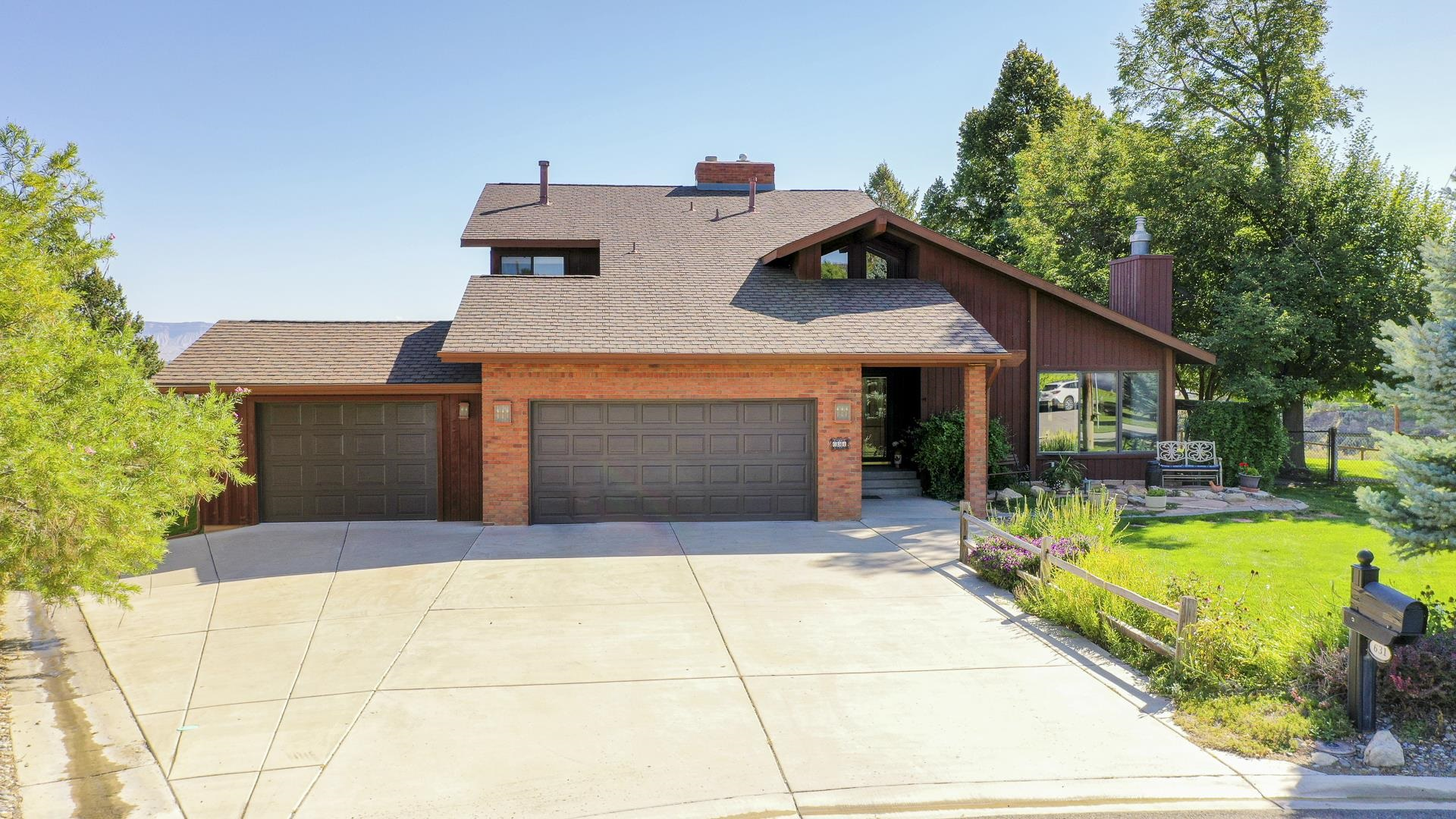This really is ONE OF A KIND!!  Situated on just over 2 acres, the expansive views of the Bookcliffs, Mt Garfield, Grand Mesa & the valley floor from virtually every window is the focal point of this amazing home. This home has so many things to offer starting w/ 2 living areas + loft, formal dining & breakfast nook, 5 beds, 4 baths, 3 car garage & just over 4000 sq ft. Enjoy time in the kitchen which is light, bright & has plenty of counter space & prep area as well as an amazing breakfast nook to spend a quiet morning enjoying the sunrise and views! Outside you will find spacious decks that expand your entertaining area & are great for morning coffee or evening wine! Did I mention the golf green... Work on your short game right in your own backyard with the Grand Valley as your backdrop! Quiet cul-de-sac location and much more - This could be our new HOME!!