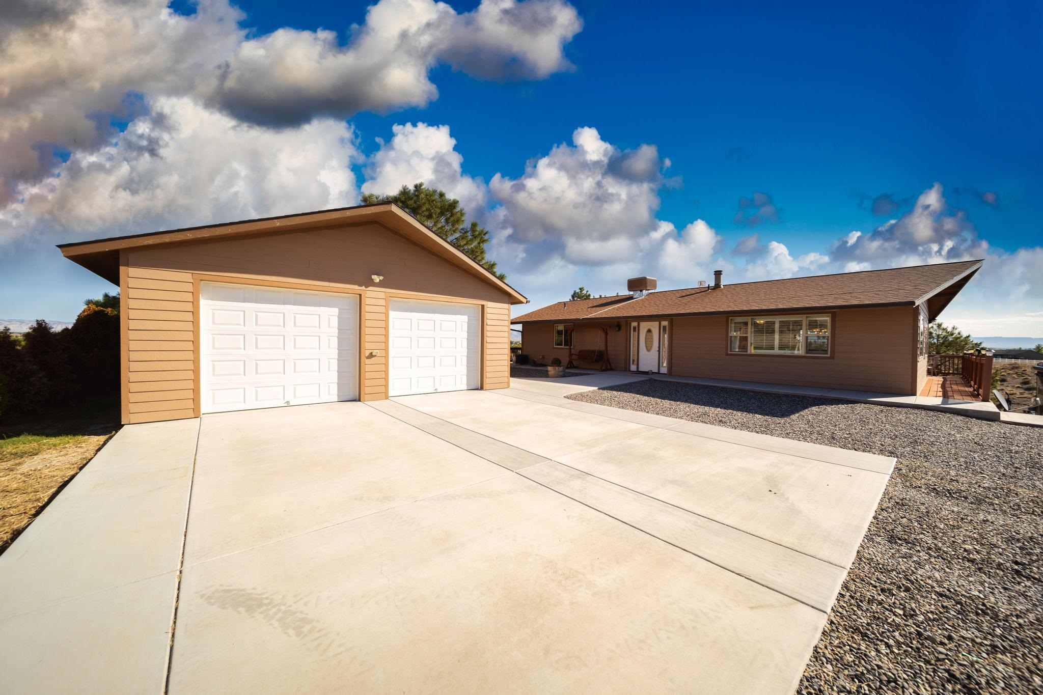 SHOWINGS WILL START ON MONDAY 9/20/2021.  Walkout Ranch style home, with 3 beds plus an office, 2 1/2 Baths on 37.67 acres where 2 sides of the property border BLM land and State of Colorado Open Space and 15 irrigated acres through the Kiefer lateral.  Irrigation uses diesel powered irrigation pump with hydraulic propelled wheel and sprinkler system.   Views Galore can be enjoyed from the new kitchen or open living room and dining room through the lovely plantation shutters or you can enjoy the views from the wrap around Trex deck. Store your harvest goodies in the canning pantry, tinker in the workshop or in the detached oversized 2 car garage. In-ceiling radiant heat and wood burning stove make it cozy in cooler temperatures. Storage shed, 5 stall horse shelter, lots of PRIVACY and VIEWS.