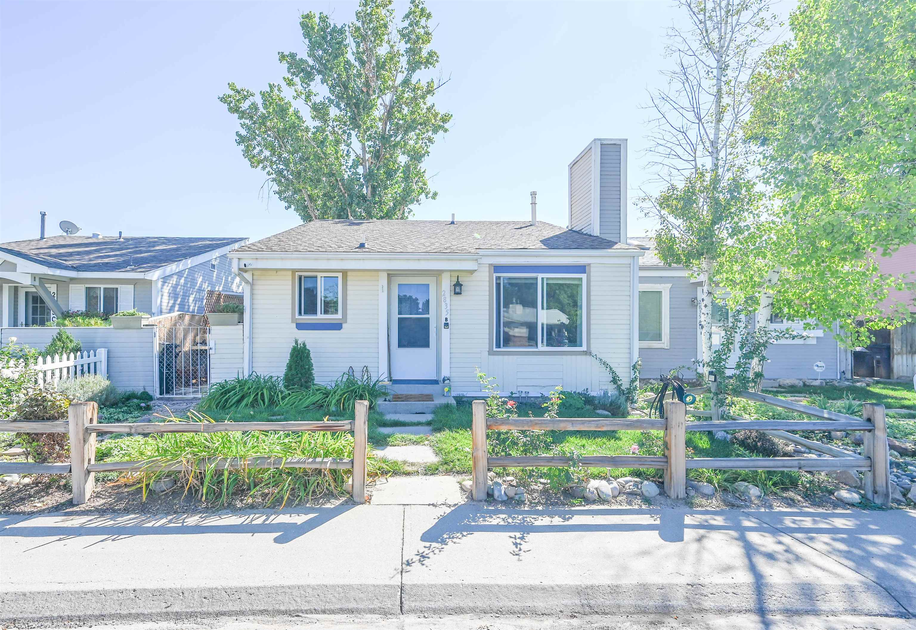 Completely updated ranch style townhome in a nice neighborhood.  Butcher block countertops, wood laminate flooring, stainless steel appliances all in an open concept.  Breeze air cooler with multiple drops for air to move throughout the house and keep it comfortable. NO HOA! Has a nice fenced in yard with lush vegetation and views of the Uncompahgre.  One car garage and additional parking in the alley. Enjoy cool fall evenings at nearby Teardrop and Village Nine Parks. Call today for a showing!!