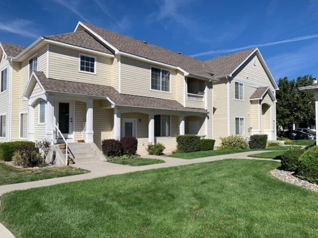 Super clean and sharp ground level ranch style condo.  This unit includes all the appliances, also full use of the swimming pool and a detached single car garage. Unit is light and bright, separate laundry room, kitchen is open to living space with gas log fireplace.  Small enclosed patio off living space with storage area.