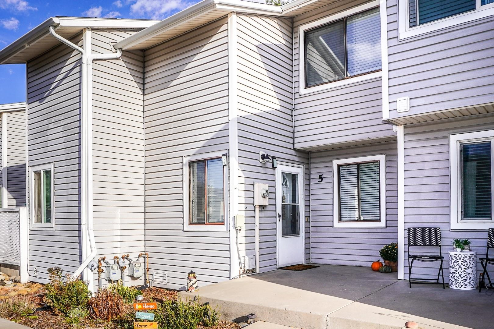 Absolutely adorable and updated Townhome.  So much to love here.  2 bed, 1 1/2 baths, small fenced private back yard with pleasant patio and a storage closet. Stackable washer/dryer right in your own unit!!  The larger bedroom has a huge walk-in closet!   Really lovely kitchen with solid surfaces and all appliances.  The HOA dues are $146 per month and include your water, sewer, trash, park/play area, exterior maintenance, exterior insurance, and 2 assigned parking spaces right out front! Please submit offers by Monday Sep 27th at 2pm, and make acceptance by Tuesday Sep 28th at 10am.