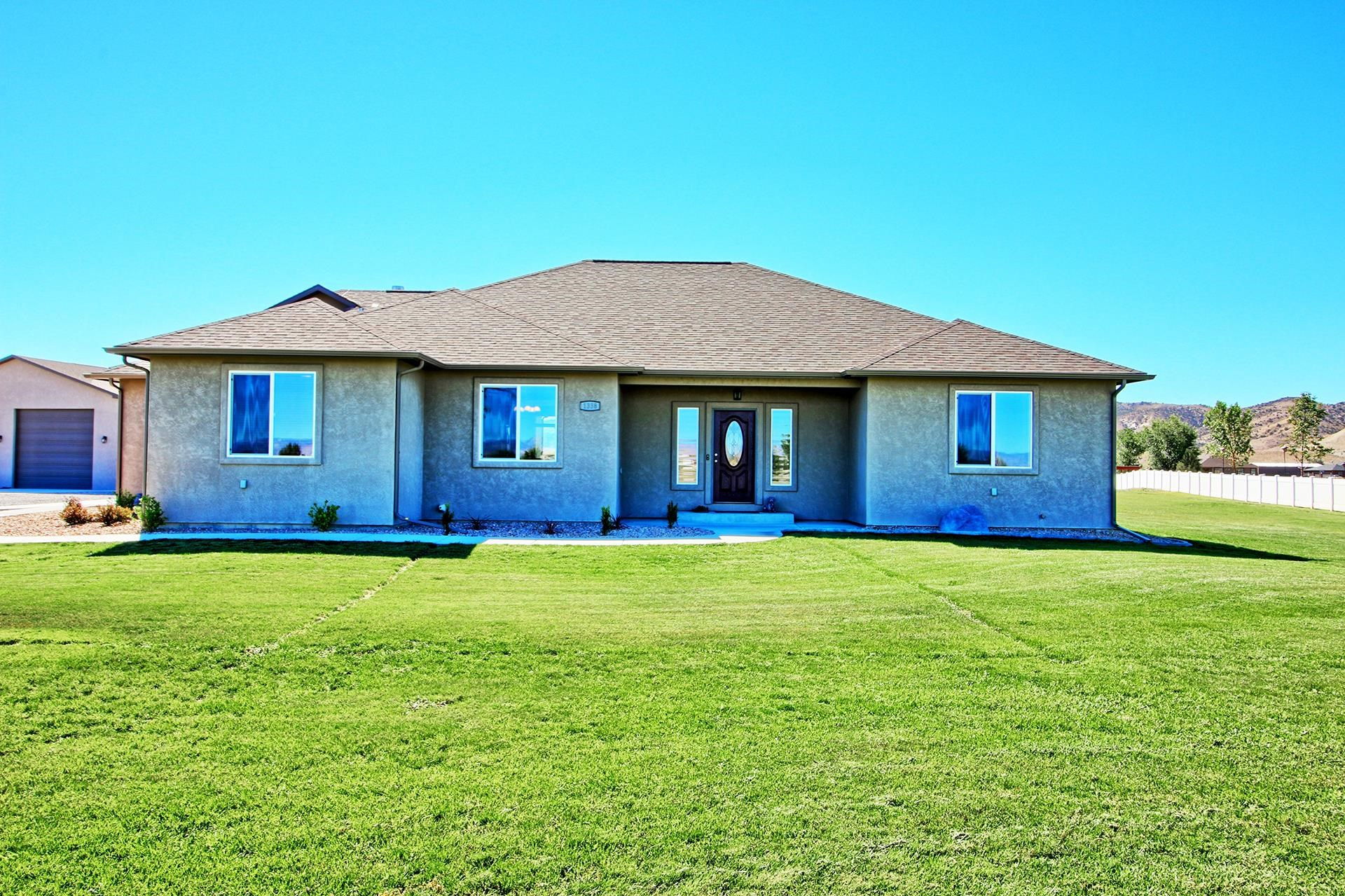 Looking for small acreage that allows for some elbow room with a view plus a shop? Search no more! This beautiful, low maintenance, open concept ranch style stucco home with a split bedroom design is situated perfectly on just shy of 2 irrigated acres with an oversized 4 car attached garage in addition to the 40x40 shop! This custom built 3-bedroom, 2-bathroom home is 2087 square foot features an open living room with vaulted ceiling and a pellet stove, beautiful kitchen with a breakfast bar, fabulous master bedroom with his and hers walk in closets and a tiled 5-piece master bath, and so much more! Come fall in love with what this home truly has to offer!