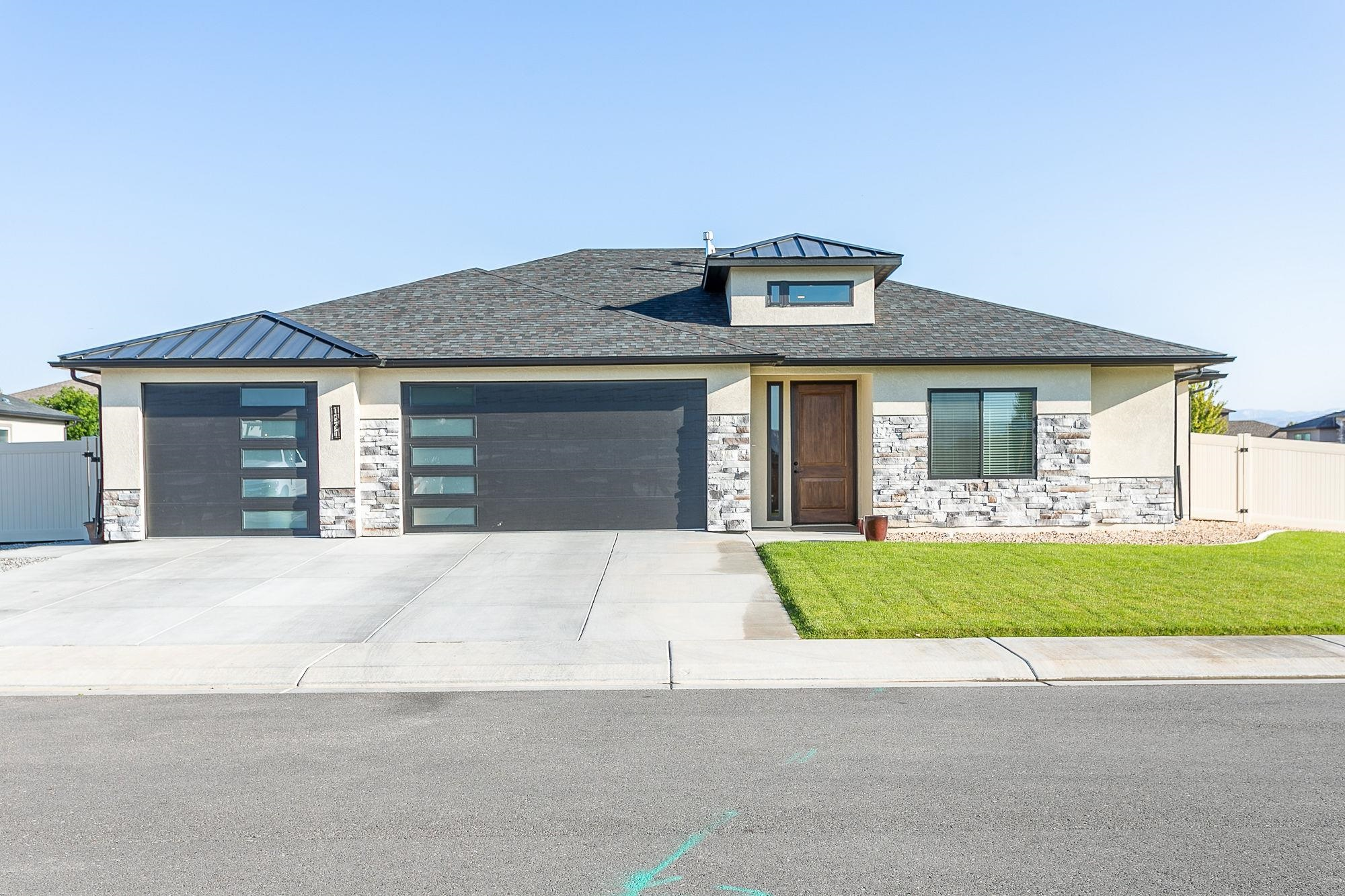 Welcome to 1591 Elmont Ct. in the desirable Brandon Estates in beautiful Fruita! This home was built in 2021 and has all the features one would desire! With 2,100 sq. feet, 4 bedrooms - 2 of them designed as masters - 3 bathrooms and a 3 car garage, finished with epoxy flooring! Inside you will find an open concept living room with welcoming gas fireplace, spacious kitchen and dining area with huge walk in pantry, and large windows giving tons of natural light! Soft close cabinets and many more upgrades are found all throughout the home including walk in closets in each bedroom, Alder Wood doors, and LVP flooring. This home is built on .28 of an acre and is fully fenced and landscaped with a shed + large RV parking, the perfect place to store all your toys!  This turn key home is close to schools and everything to love about Fruita! Welcome home!
