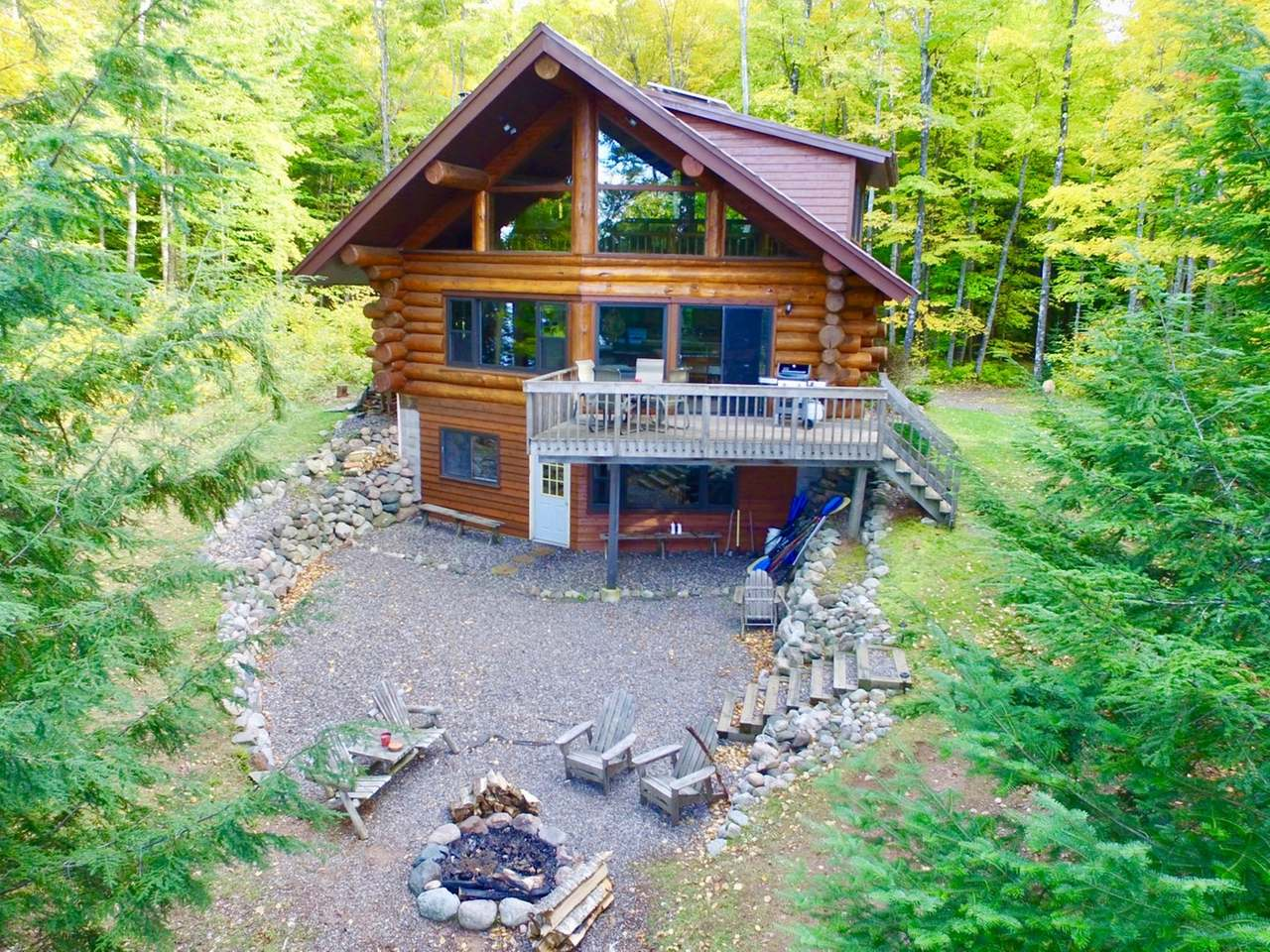 Beautiful full log cabin on secluded 71 acre Lehto Lake. This 2 BR, 2BTH fully off the grid getaway offers 129 acres of amazing mature wilderness surrounded by large private tracks of land. The land features large eskers, trails and hunting plots throughout. The property has 350ft of sand North West facing frontage and is 1 of 3 homes on the entire lake. The cabin is constructed with huge logs and is equipped with solar panels and LP and offers a high-end kitchen and bathrooms with granite countertops and well-crafted cabinetry. Lehto Lake is a great fishery with Panfish, Bass, and Northern Pike. Only 30 mins from Minocqua and 25 mins from Manitowish Waters, this property is centrally located to many shops, restaurants, bars, trails, state land and much more! Schedule an appointment today!