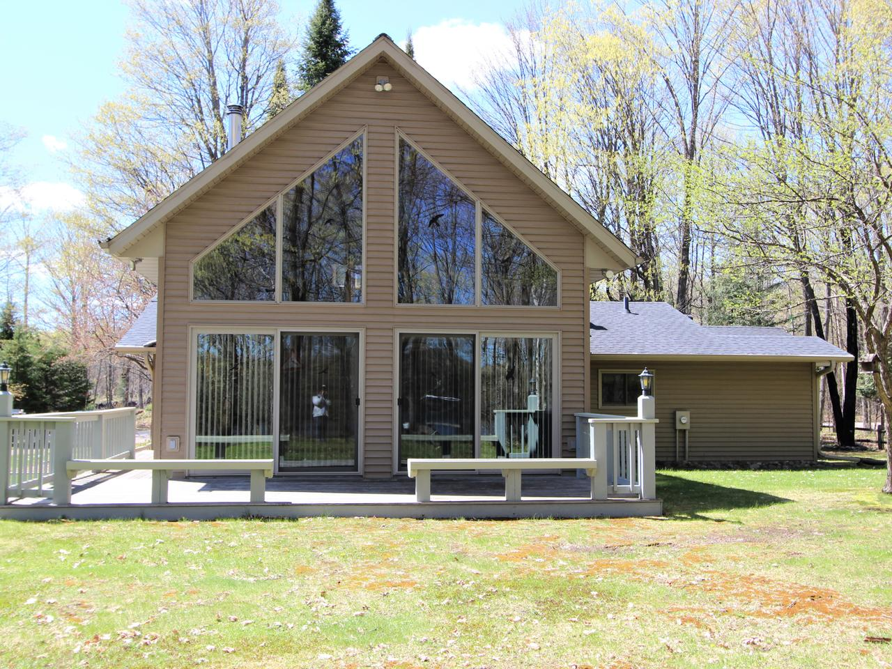 "Premier home in the heart of the true Northwoods. This home features cathedral ceilings, chalet style home with a wall of windows facing the lake. Northwoods decor and knotty pine throughout keeps the home bright and light. The great room features a free-standing field stone fireplace. The views from the loft are awesome and supplement the additional 3 bedrooms and 2 baths. Crystal clear water, prime fishing and the ability to boat both Little Hurst and Big Hurst Lake is a rare combination. The exterior is maintenance free and the over sized two car garage is insulated and heated with substantial additional storage attached to the rear. This is one our most sought-after areas with destination bike trails and snowmobile trails at your fingertips. Location, quality and value make this home a ""must see!"""