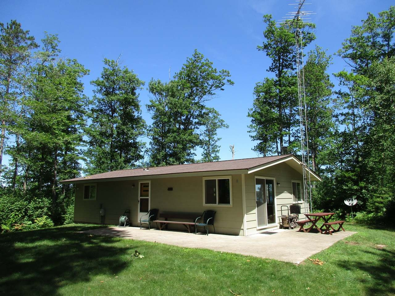 Rare Offering on Clear Lake of the Manitowish Chain of Lakes. End of the road privacy is found at this 2BR, 1BA home with 2+ car detached garage. This property offers 326 +/- feet of perfect frontage as well as 2.95+/- acres of well wooded Northern Wisconsin Solitude. Home comes furnished as shown. The location of the improvements on this parcel allow for expansion or the construction of a larger residence - there is a gorgeous building site located adjacent to the home. New survey (2018) clearly shows all lines and corners. New conventional septic (2015). The property adjoins 1,000's of acres of the Northern Highland American Legion State forest which ensures the current secludedness will last a lifetime. Whether you're looking for a buildable lot, or property with a solid home on the best lake of the Manitowish Chain, you've just found both!