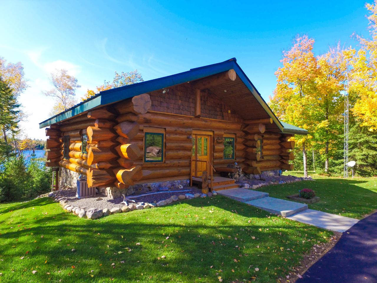 Magnificent Pioneer Log Home with Western exposure on one of Boulder Junction/Presque Isle's premier lakes w/48x45 in-floor ht'd garage w/room for RV Storage.This 3BR, 3BA home features high-end appliances, granite counters, maple cabinets, master ensuite /travertine tile, in-floor heat, air handler w/AC, high efficiency condensing boiler, & Trex decking. A short distance to downtown Boulder Junction offers easy access to many restaurants, biking & snowmobile trails. The property consists of 2.6 acres of wooded high ground, 252' of frontage with year-round sunsets overlooking thousands of feet of state-owned property! The vacant adjacent lot with 207' frontage and 2.3 acres is also available. Pioneer Log Homes are one of the world's top luxury log home builders using logs out of British Columbia, the Majestic Western Cedar. Wildcat Lake is 300 acres, 38' deep & sand bottom and has connecting lake, Big Kitten is 50 acres, 22' deep, & over 90% state-owned.