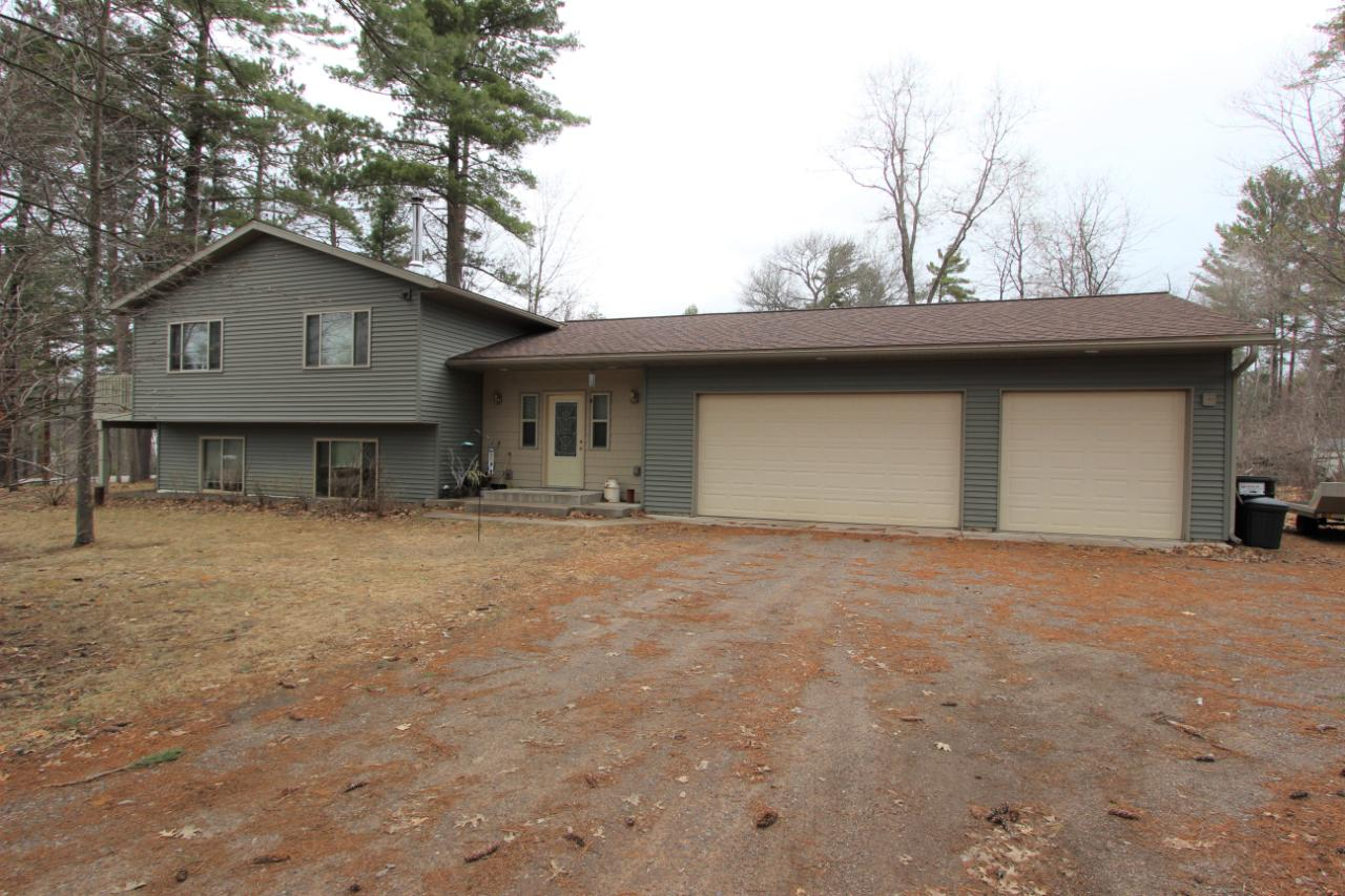 Custom built 3 bedroom, 3 baths home close to town. Quality wood finishing's throughout, open concept kitchen living and dining area. The master suite has a walk-in shower, whirl pool and double sink vanity and his and her closets. The lower level offers a large rec room, 2 bedrooms, laundry room with a wash tub and a full bath. The home allows for room to sprawl with an additional 4 season sun room and den area. Attached is a deep 3 car garage. Enjoy the wildlife on the large sun deck or in the back yard. This homes quality for the price is hard to find.
