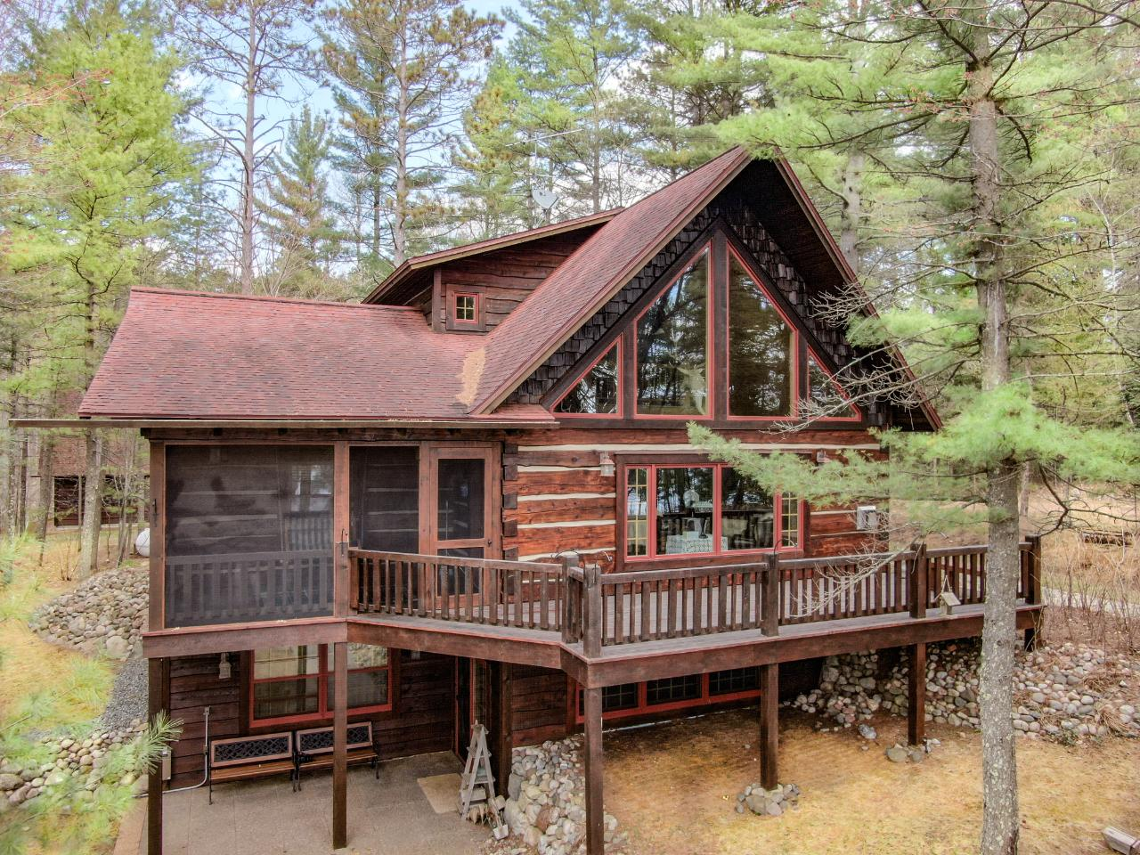MALBY LAKE LUXURY FULL LOG HOME - This 3BR/4 BA log home is the quintessential property for those with impeccable taste who are looking to enjoy the quiet Northwoods lifestyle. The property features 124 ft of frontage on Malby Lake and nearly an acre of beautifully landscaped land. The craftmanship in the home (which includes granite counter-tops, butternut cabinets, cathedral ceilings, stone fireplace, cherry flooring, cedar doors, antique clawfoot bathtub, and more!) is immediately apparent. With a bedroom with connected bathroom on every level, this home is set up perfectly as a multi-family vacation home. The detached 2-car garage compliments the house with its wood and stone siding, custom coach doors, and an extra storage room on the second floor. With all your shopping needs a short 5-minute drive away in Minocqua, this property really is the best of both worlds. The snowmobile trail is also nearby!!