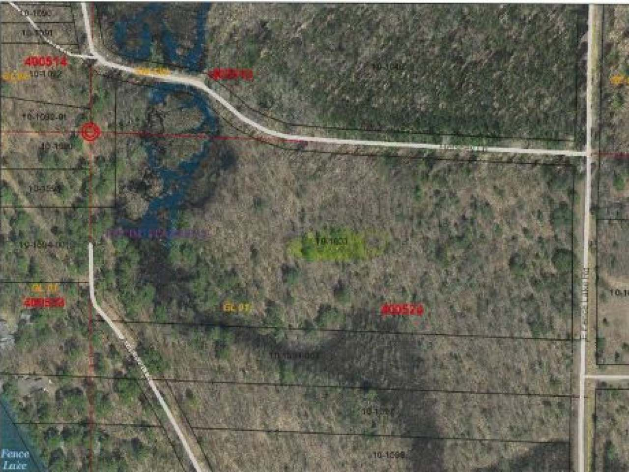 Beautifully wooded 15 acre parcel at E. Fence Lake Road and Hershey Lane. Level. Quiet area. Electric and telephone at lot line. Near the 10-lake Flambeau/Fence Chain for fishing and boating. Wonderful Parcel!