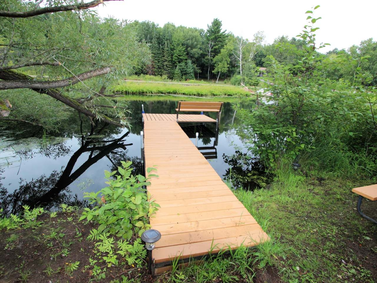 2 acres of mature towering trees with shared ownership of a lake lot on Little Arbor Vitae. Beautiful building lot with great character and close to town. The shared lake frontage is a great affordable way to get on good water.