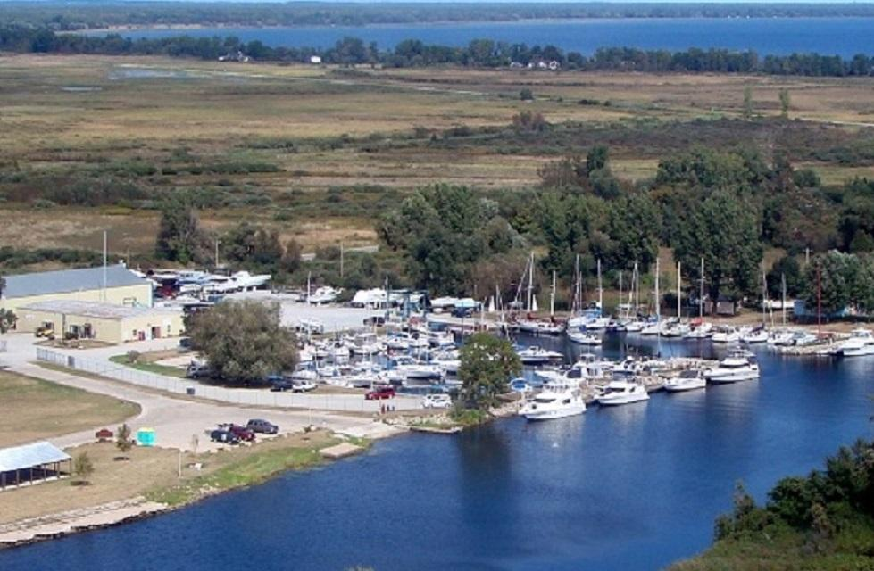 """This is a rare opportunity to own a successful marina storage and service facility on the Western shore of Lake Michigan's Green Bay. This clean, well maintained facility enjoys strong, consistent occupancy. Hi Seas Marina is a popular choice for dockage, service, and winter storage on the """"warm sandy"""" side of the bay. The facility is well maintained and consistently at full occupancy. The owner/operator has lived comfortably off of the marina and is ready to explore the next chapter of his life. There is plenty of upside for a new and motivated owner."""