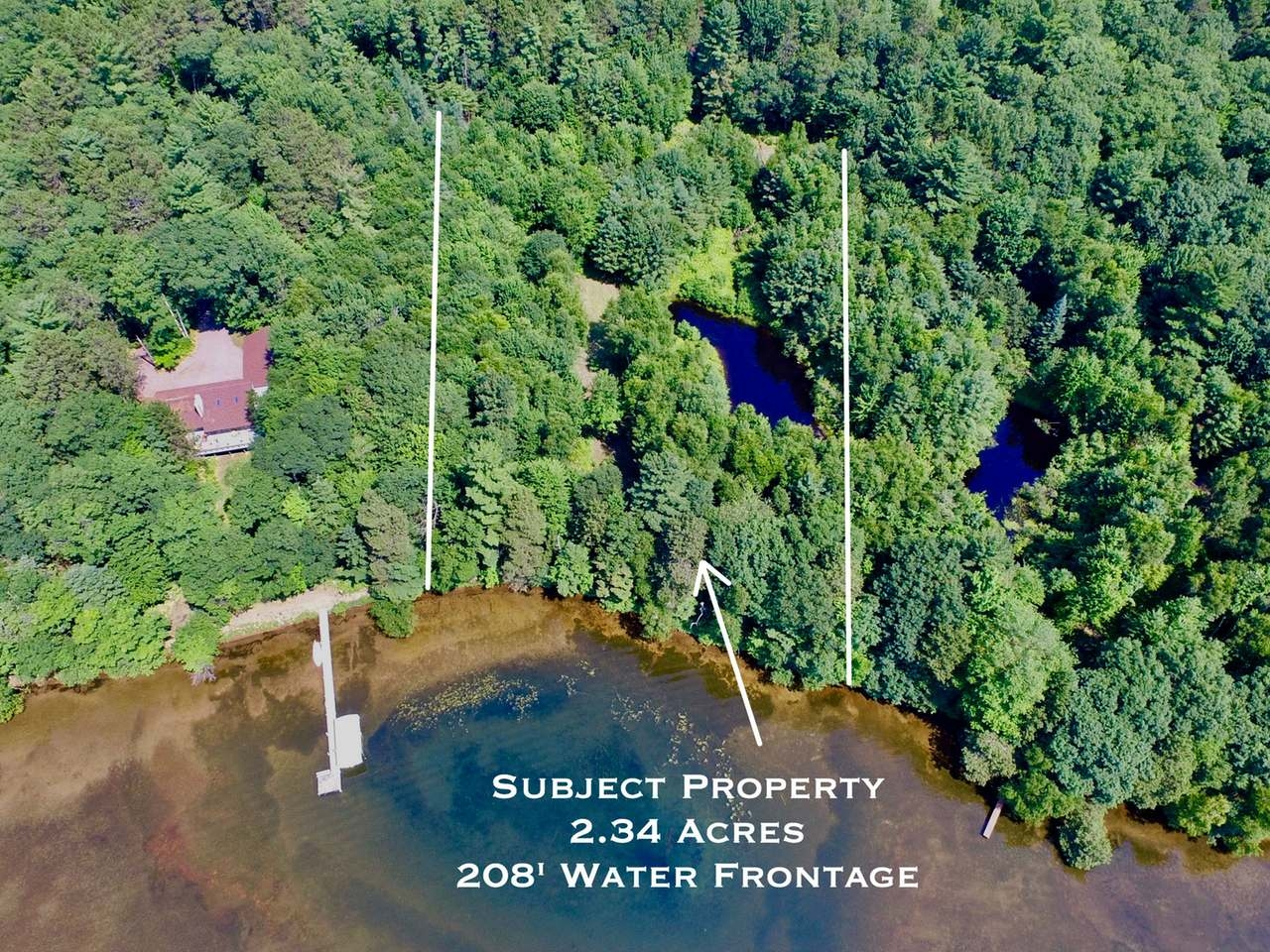 Here's the opportunity you've been waiting for on Trout Lake. This waters-edge lot has toe-wiggling sand frontage and a level approach to the water. It features big water views and a man-made pond that has been wired for illumination and a fountain, which enhances the landscaping possibilities, and there's been a driveway and a site cleared for a spectacular building location. This is the only vacant lot available on Trout Lake!