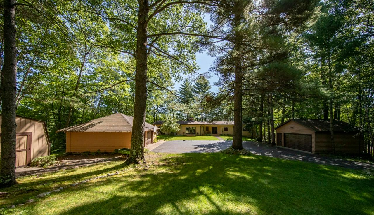 Dreaming of a private, beautifully wooded lake property with panoramic views and plenty of space for guests? The legendary Sokata Point Family Compound has been loved by family for over 50 years and has so much to offer with 6.36 acres, 750' of frontage, a main home, 2 guest cabins, 2 boathouses, 2 garages and 2 sheds. The main 5BR 3BA unique octagon shaped home boasts a desirable open concept with massive lake view windows and an expansive back deck facing gorgeous Lake Katherine. Other features of the main home are a lovely 3-season porch, 2 fireplaces & a finished walk-out LL with a kitchenette. Invite the whole gang to stay in the 1BR 1BA cabin, a 2BR bunkhouse or the heated 2.5 car garage with a BR/BA. Enjoy the benefits of lake life with a dry boat house plus track system, a fishing shed and 3 piers connected by a lakeside path. Explore the woods year-round on several nature trails. Located 4 miles from Minocqua in the charming town of Hazelhurst. www.sokatapoint.com