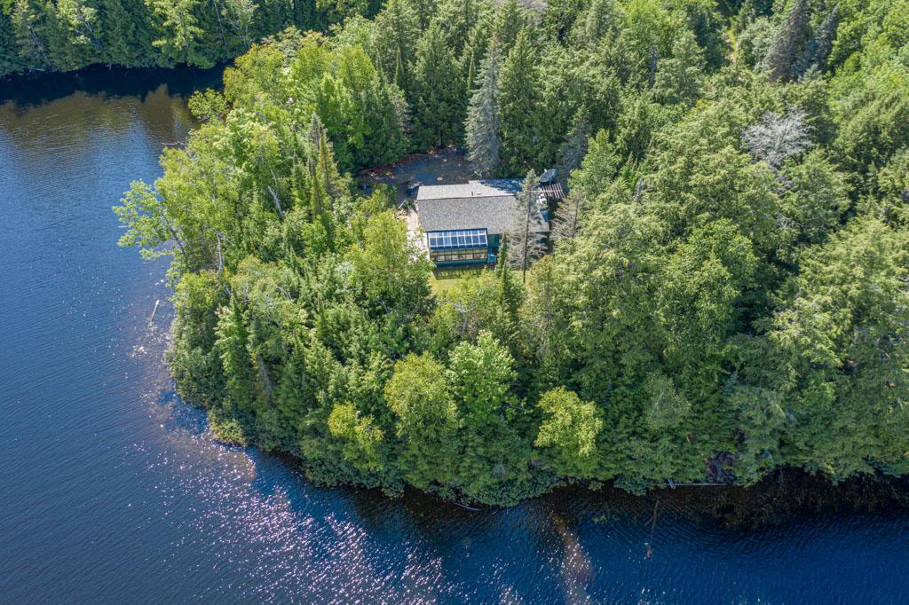 """CRAB LAKE! A once in a lifetime opportunity to be on """"Wisconsin's Most Beautiful Lake"""" (Milwaukee Journal). Crab Lake encompasses nearly 1,000 acres, 23 islands, gin clear water and 25 miles of shoreline. Situated on a gorgeous peninsula with breathtaking bluff views of the lake, the 2br/1ba home features a beautiful sun room, open floor plan, full basement, storage shed, 2-car detached garage and a handsome field stone fireplace. Enjoy this marvelous property as a vacation retreat, upgrade or update to your heart's desire, let your imagination run wild-sales are extremely rare on Crab Lake as most properties are handed down through generations of families. A special permit from the DNR is in place for a 24' x 6' pier and a permit for a 5' fence near the home for dogs. This property speaks for itself-come take a look today and claim your spot on the most sought-after lake in Northern Wisconsin!"""