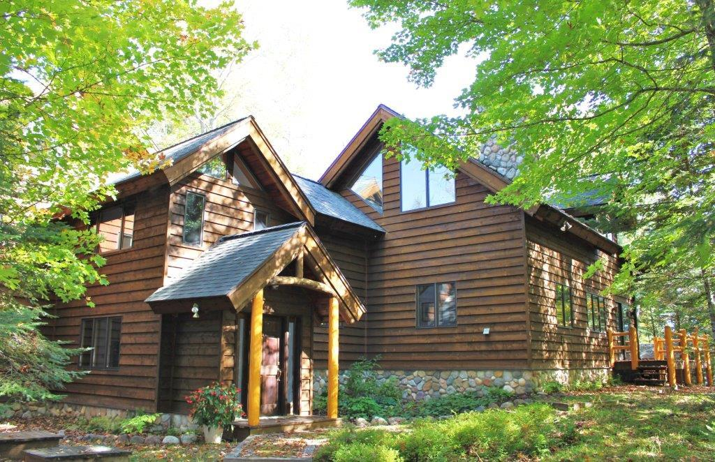 Discover the Lone Pine Lake Experience; so far yet so very near, between Boulder Junction and Presque Isle. Only 15 homesteads surround this pristine, 140 acre private lake w/40' depths, unsurpassed fishing & wildlife. Creatively crafted, custom home on a point of 1,000 ft.of lake frtg. 9 wooded acres within the private Lone Pine Owners Ass'n covering thousands of preserved forested acres, a nature lover's paradise. Open concept, soaring ceilings and open spaces provide a light & airy feel. 3 BR, 4 BA. Lots of natural light with abundant Pella windows. Beautiful built-ins, maple cabinetry, Flr-to-ceiling stone FP. Master suite with soaking tub, separate shower. Lakeside screen porch w/circular log stairway to loft. Att. 4 car gar, wrkshp, plus det. 2 car gar with guest quarters/studio above providing 904 sq ft finished living space. 2 piers. Escape to Lone Pine for the ultimate respite and finest lake living. Nearby fine dining, boutique shopping, bike/ski/snowmobile trails.