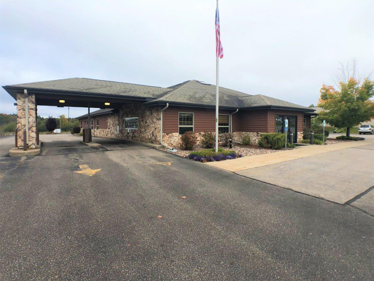 Office Building/ Retail Space/ Commercial property. Lincoln St. is the busiest commercial corridor in Rhinelander, WI, and here is a prime piece of real estate located right in the heart of it all. This building offers a total of 8,982 sqft with the main level accounting for 4,527 sqft and the lower level accounting for the other 4,455 sqft. The upper level consist of 2 large lobby area's/ a counter area formerly used for bank tellers/ 3 bathrooms/ 10 offices and a conference room/ storage areas and a vault. The lower level consists of a large mechanical or storage room that is unfinished/ a second mechanical room/ file room with shelving/ employee break room/ 4 offices or work rooms/ 2 bathrooms. This property consists of 1.14 acres of land with 2 curb cuts onto Lincoln St. and has over 40 private parking spaces. There is also a covered drive up if your business could utilize that convenience. The building is in very good shape and ready for you to view today!
