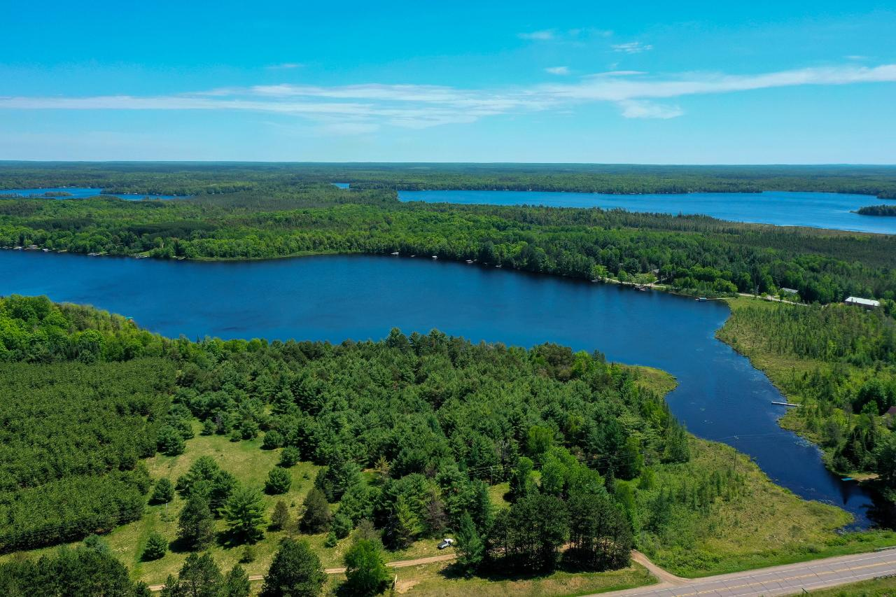 Looking for a large parcel on the Three Lakes Chain? Finding something private and on the chain can be difficult. Here is a 10.8 acre parcel with over 1500' of frontage on Crystal Lake. The parcel has utilities at the road. It is partially wooded, partially cleared. It could be developed and subdivided too! The parcel has frontage on US 45 south so it could be visible if you so choose. The land is mostly high and dry and there are multiple building sites.
