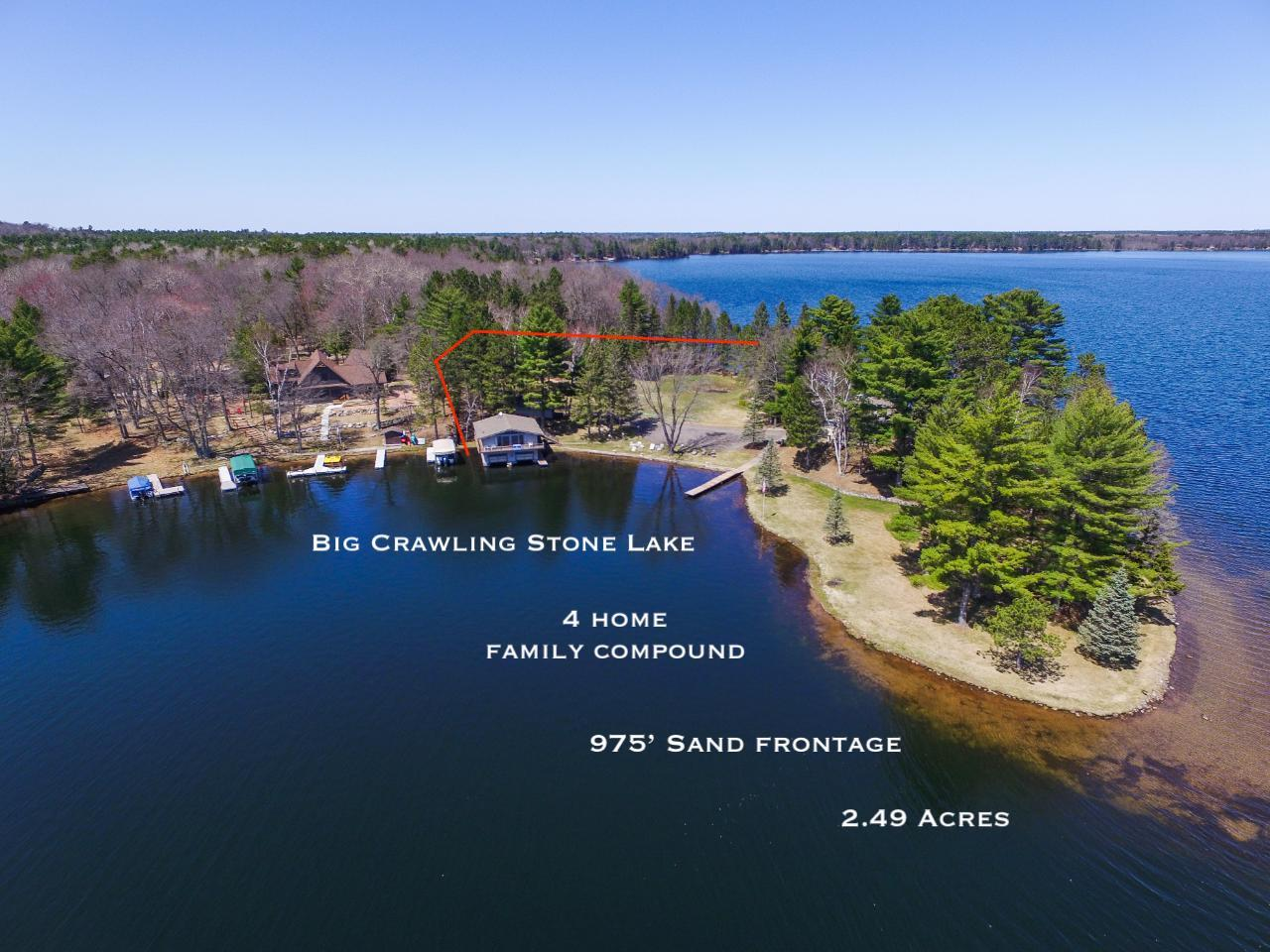 Crawling Stone Point Estate. Rarely does an estate to this stature become available. Here is your chance to own a sprawling compound with a wet boathouse and multiple guest homes that encompass the entire peninsula with the utmost privacy. Big Crawling Stone Lake (part of the 10 lake Fence Chain) is known for its sandy beaches, gin-clear water, and excellent fishing. The grand main home features 3 BR, 3 BA, a stately great room with stone fireplace, and water views from every room. The wet boathouse has 3 BR, full bath, & kitchen. Below are 2 stalls to park your inboard ski boats and endless toy storage. There are 2 guest homes that each have 3 BR, a full bath, kitchen and multiple garages. This property has been in the same family for many generations with so many memories created here. With 2.49 acres and 945' perfectly level frontage, you would own one of the rarest parcels on this lake with endless lake views! Visit www.crawlingstonepoint.com for add. info!
